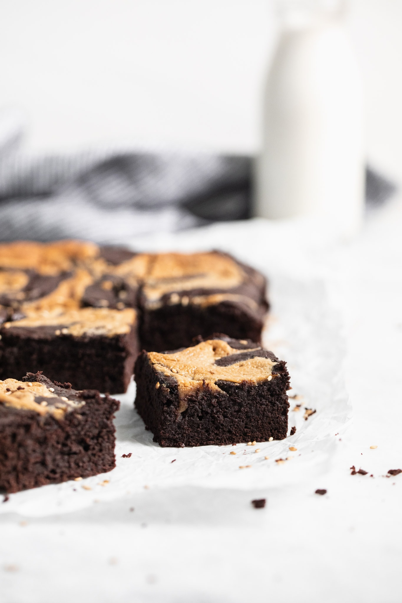 Introducing Halva Brownies AKA thick fudgy brownies swirled with ribbons of halva, my favorite middle eastern confection. Think tahini brownies, but better!