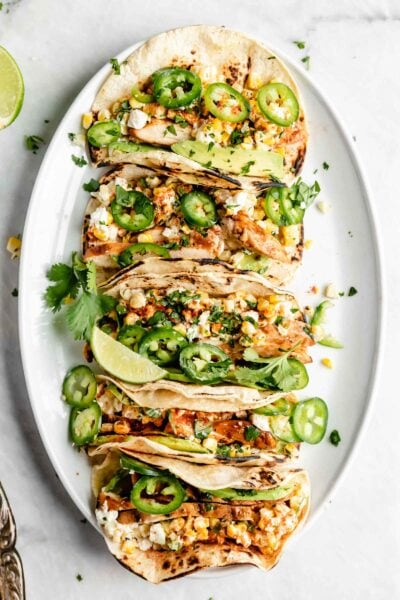 Loaded BBQ Chicken Street Corn Tacos made with fresh corn, crema, avocado, tender chicken, and cotija cheese. What more could you ask for?