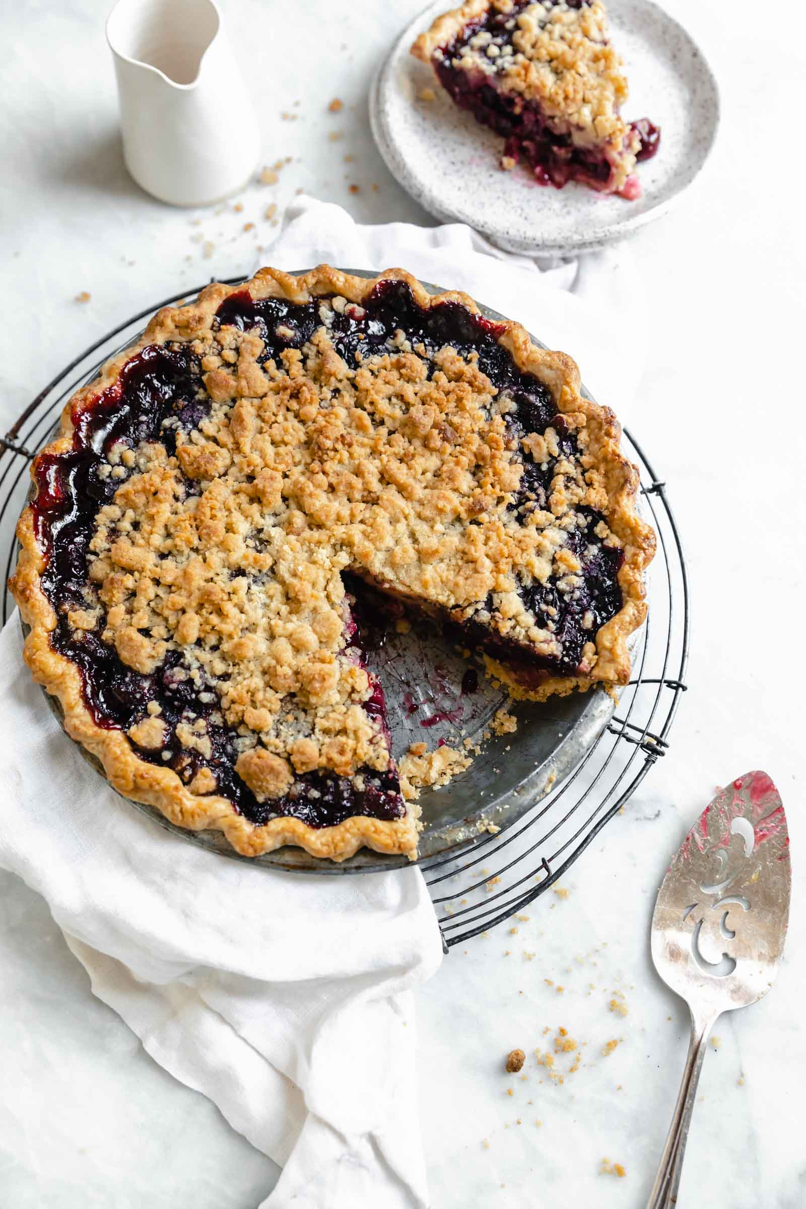 Introducing our favorite summer pie: Cherry Crumb Pie. A flaky pie crust filled with fresh cherries, and topped with crumble. The perfect cherry pie recipe!