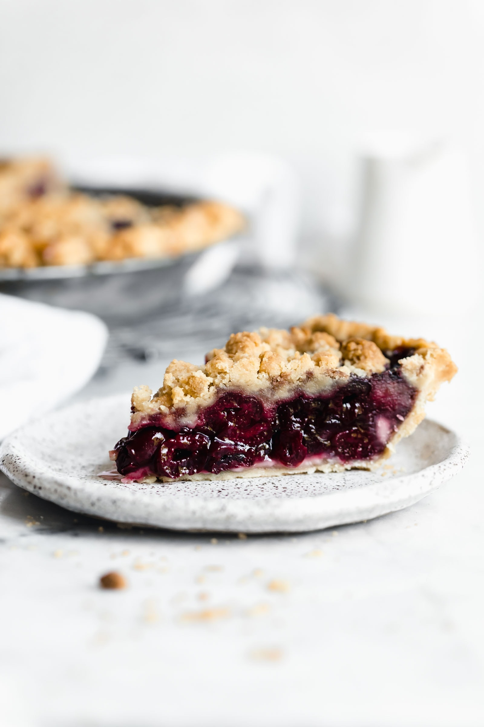Introducing our favorite summer pie: Cherry Crumb Pie. A flaky pie crust filled with fresh cherries, and topped with crumble