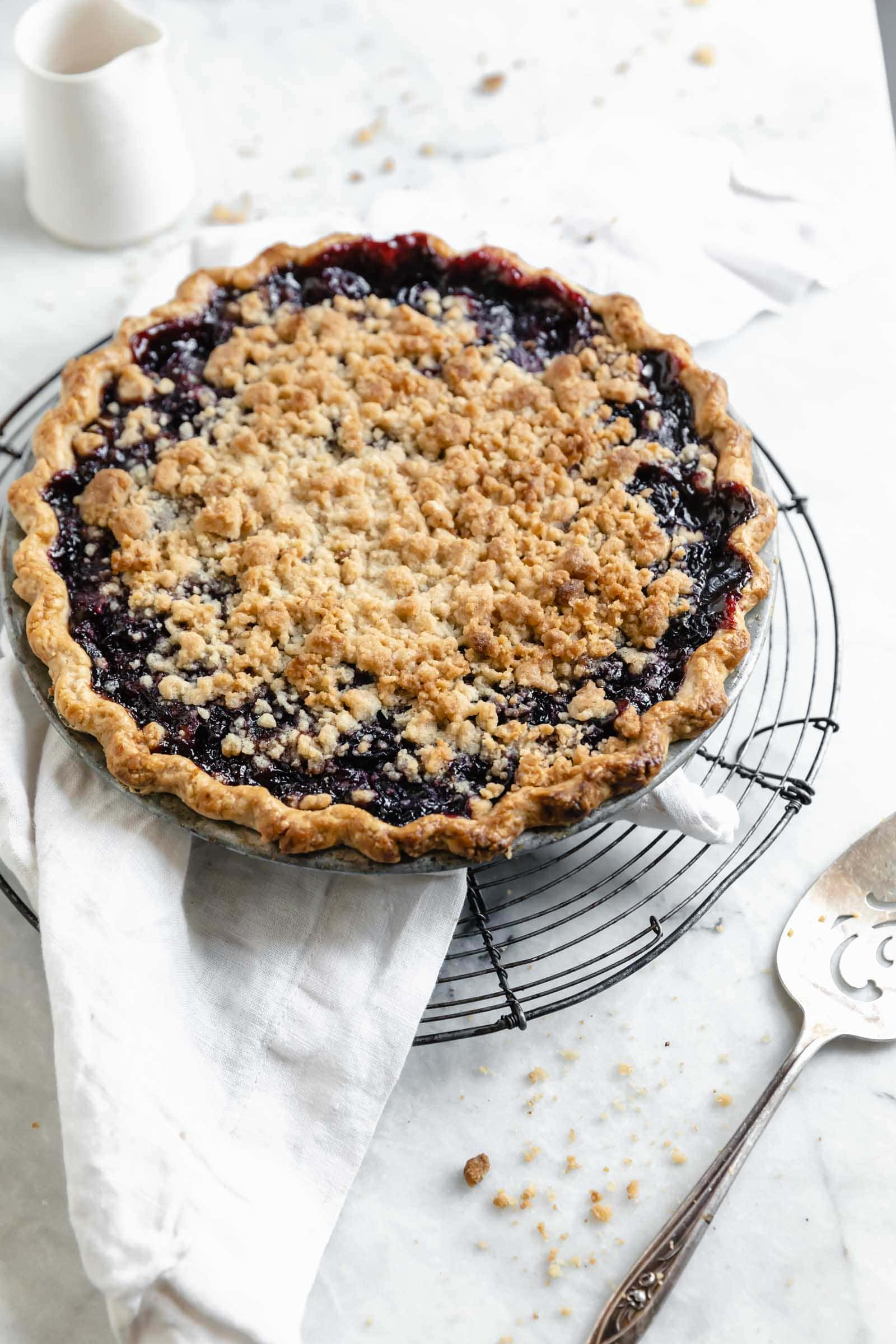Introudcing our favorite summer pie: Cherry Crumb Pie. A flaky pie crust filled with fresh cherries, and topped with crumble. The perfect cherry pie recipe!