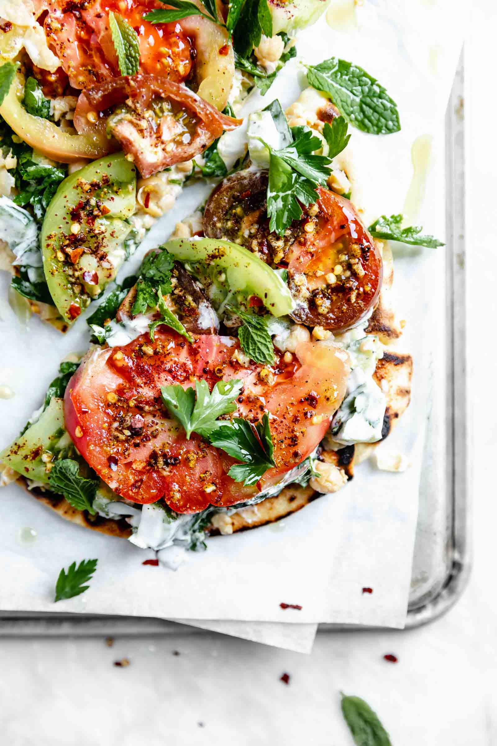 falafel-spiced tomato and chickpea flatbread drizzled with olive oil