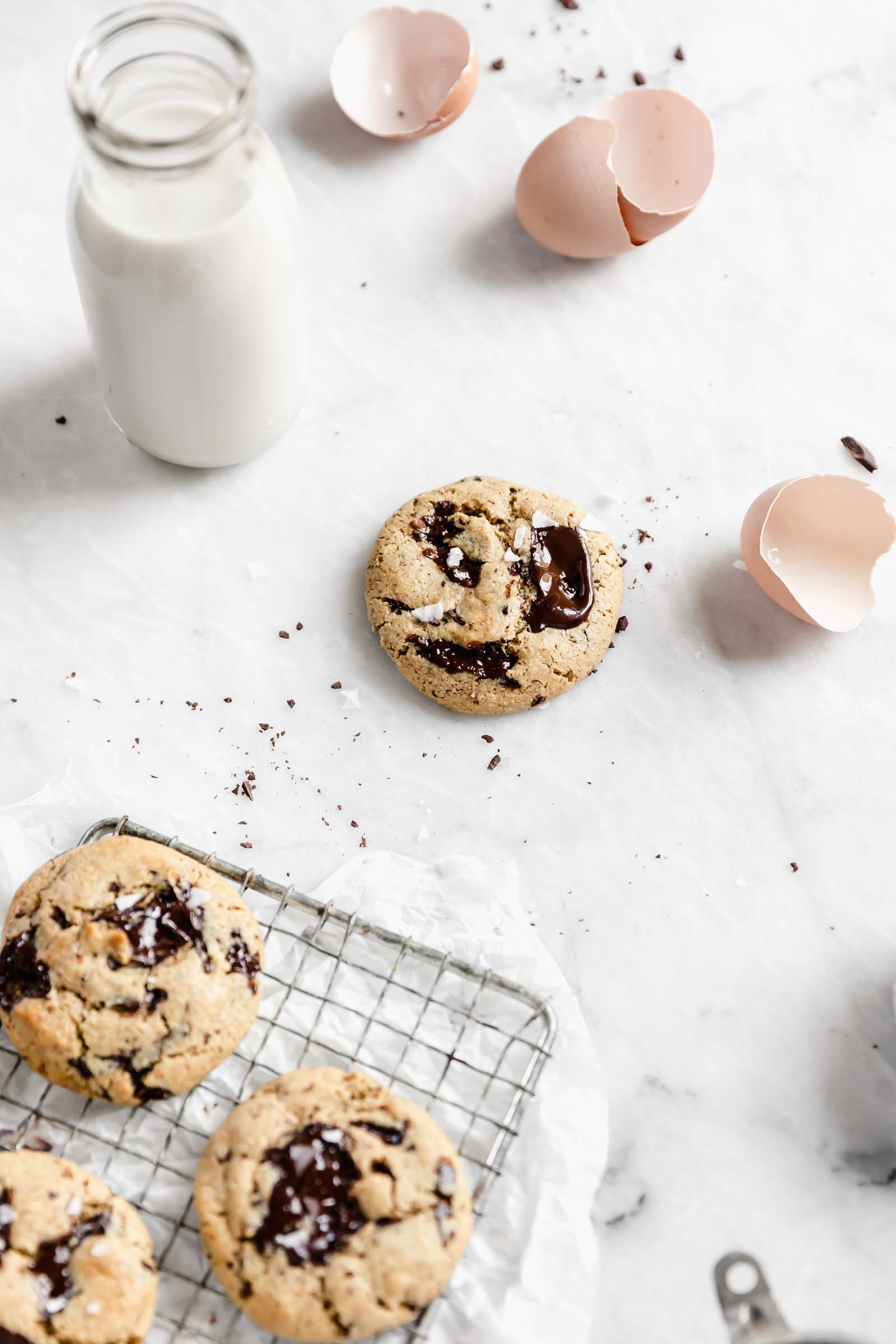 chocolate chip cookie with egg shells, milk and more cookies