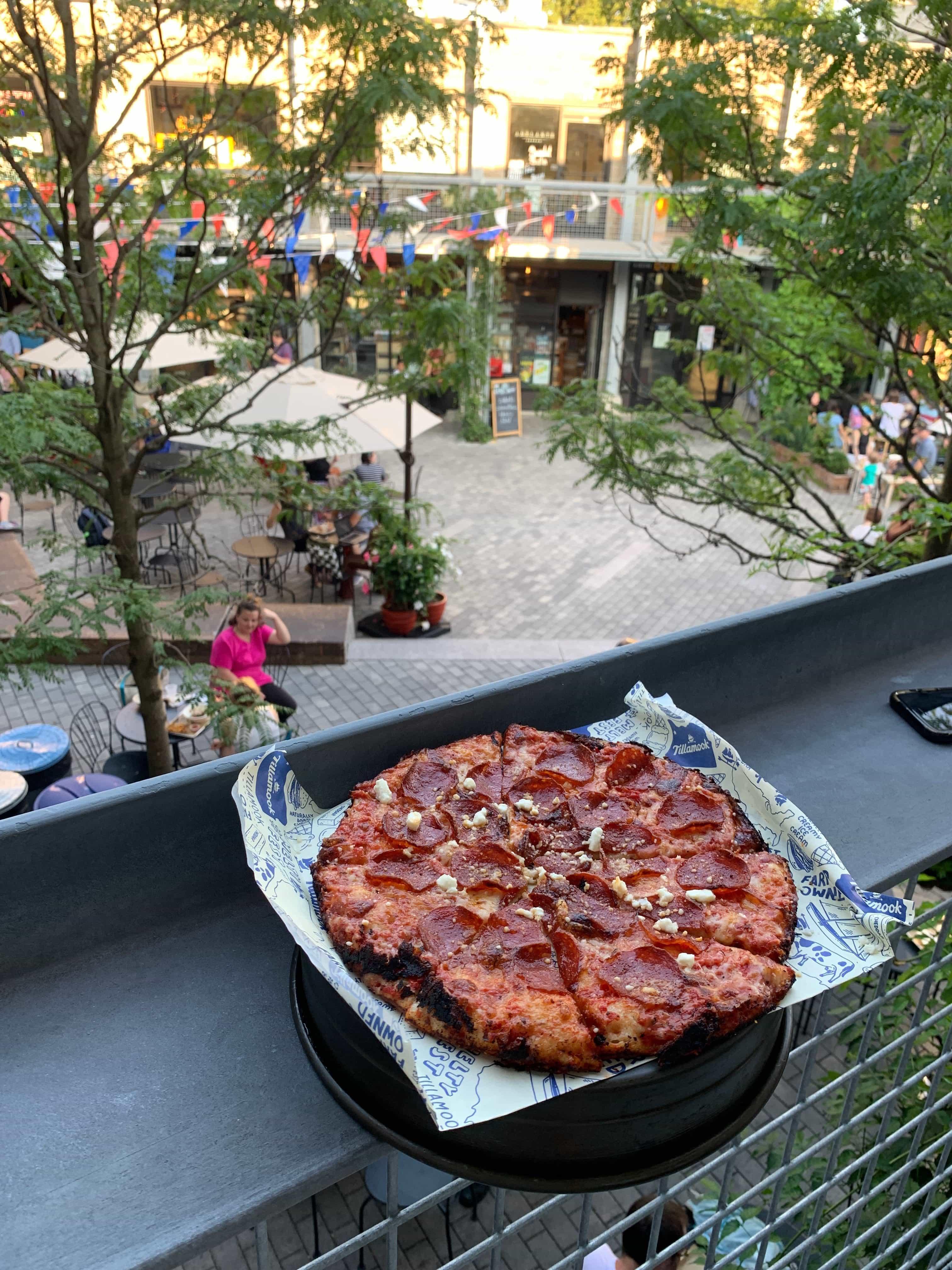 pepperoni pizza on a ledge