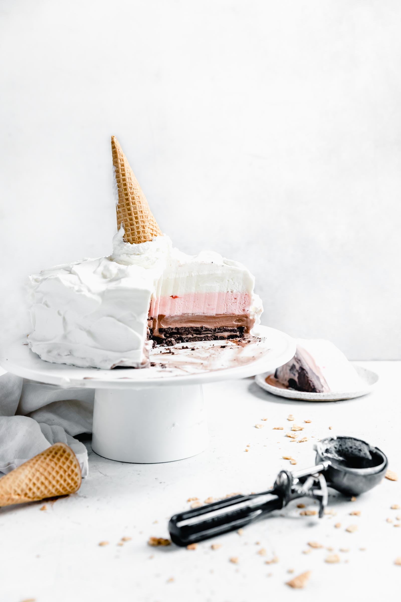 Neapolitan ice cream cake with slice out