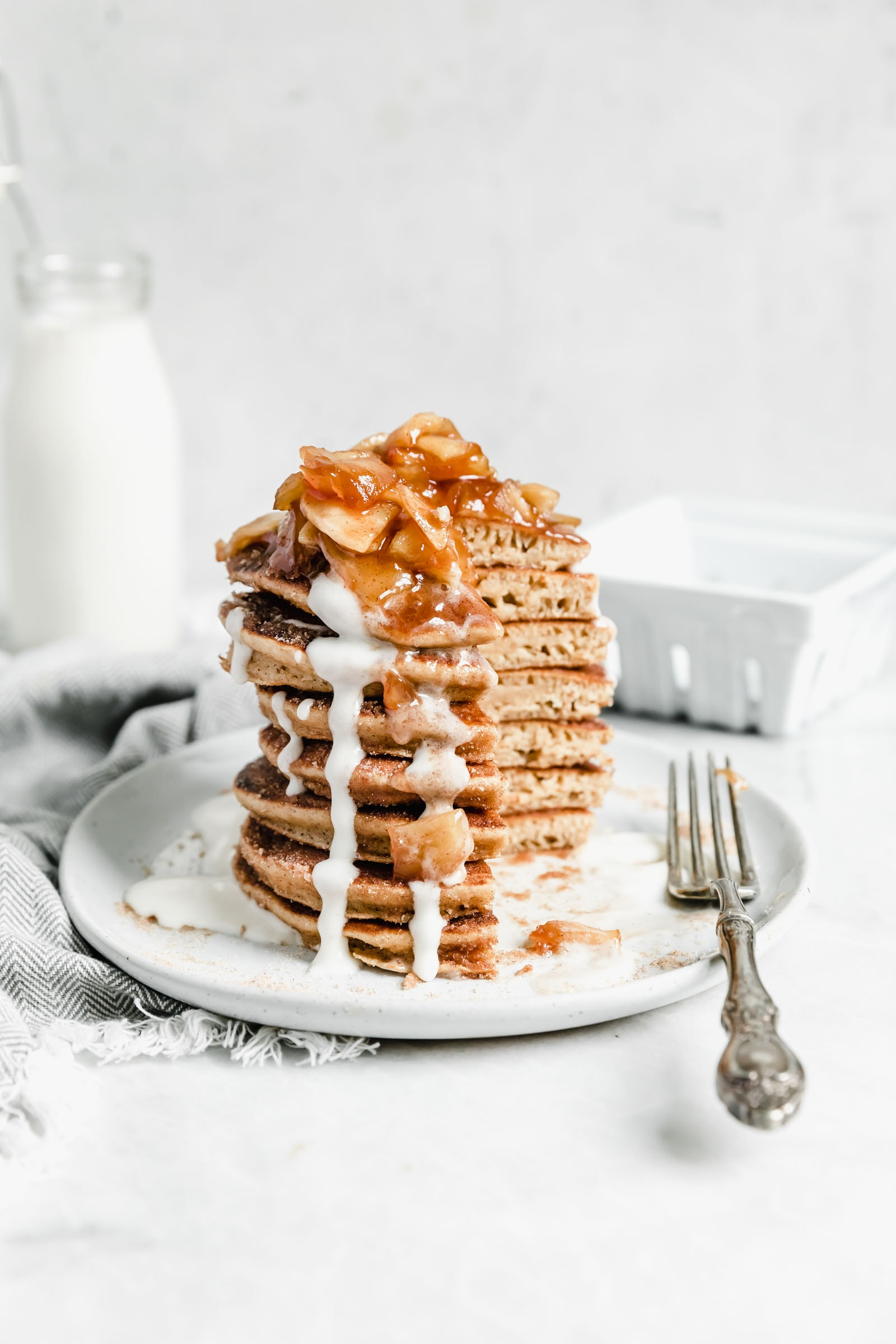 stack of apple cider donut pancakes with quarter taken out