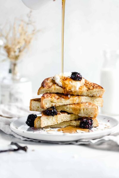 bourbon vanilla french toast drizzled with maple syrup pour