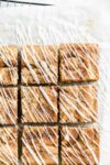 overhead shot of cinnamon roll blondies drizzled with cream cheese glaze
