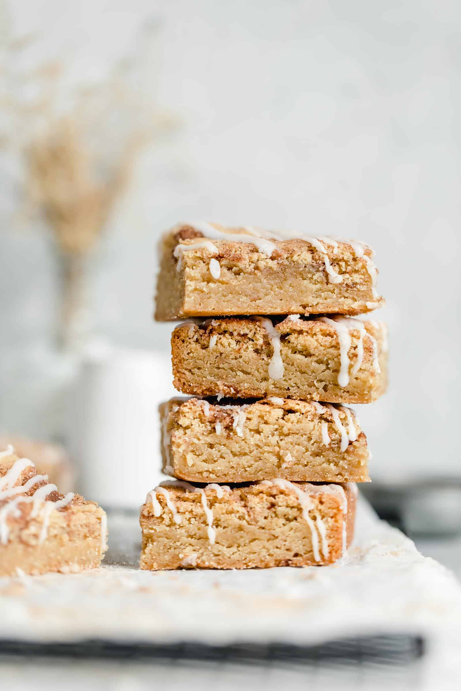 stack of cinnamon sugar blondies drizzled with icing