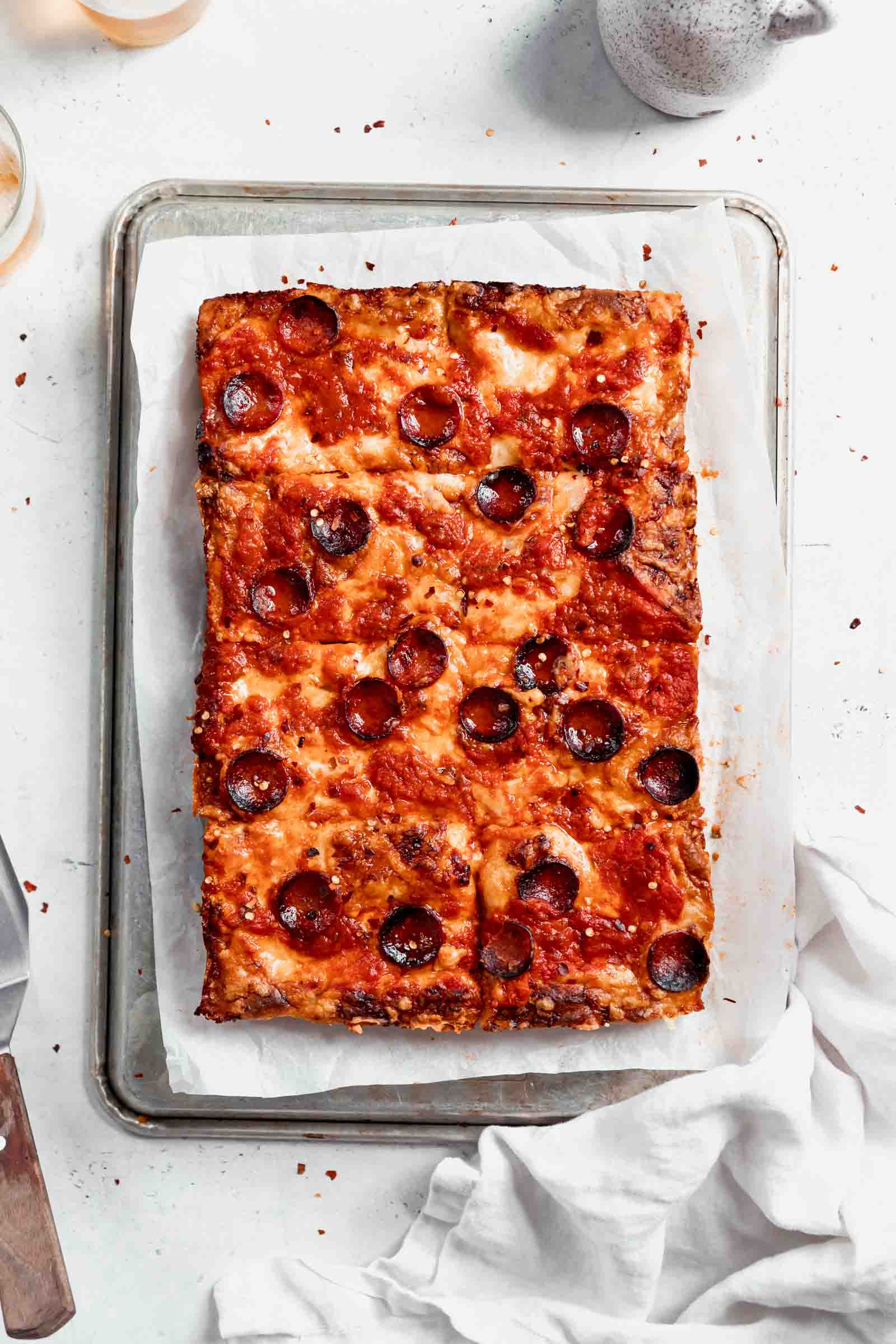 Crispy on the outside, chewy in the middle, Detroit-Style Pizza topped with two pounds of cheese, sauce, and your choice of topping. Um, can you say drool?