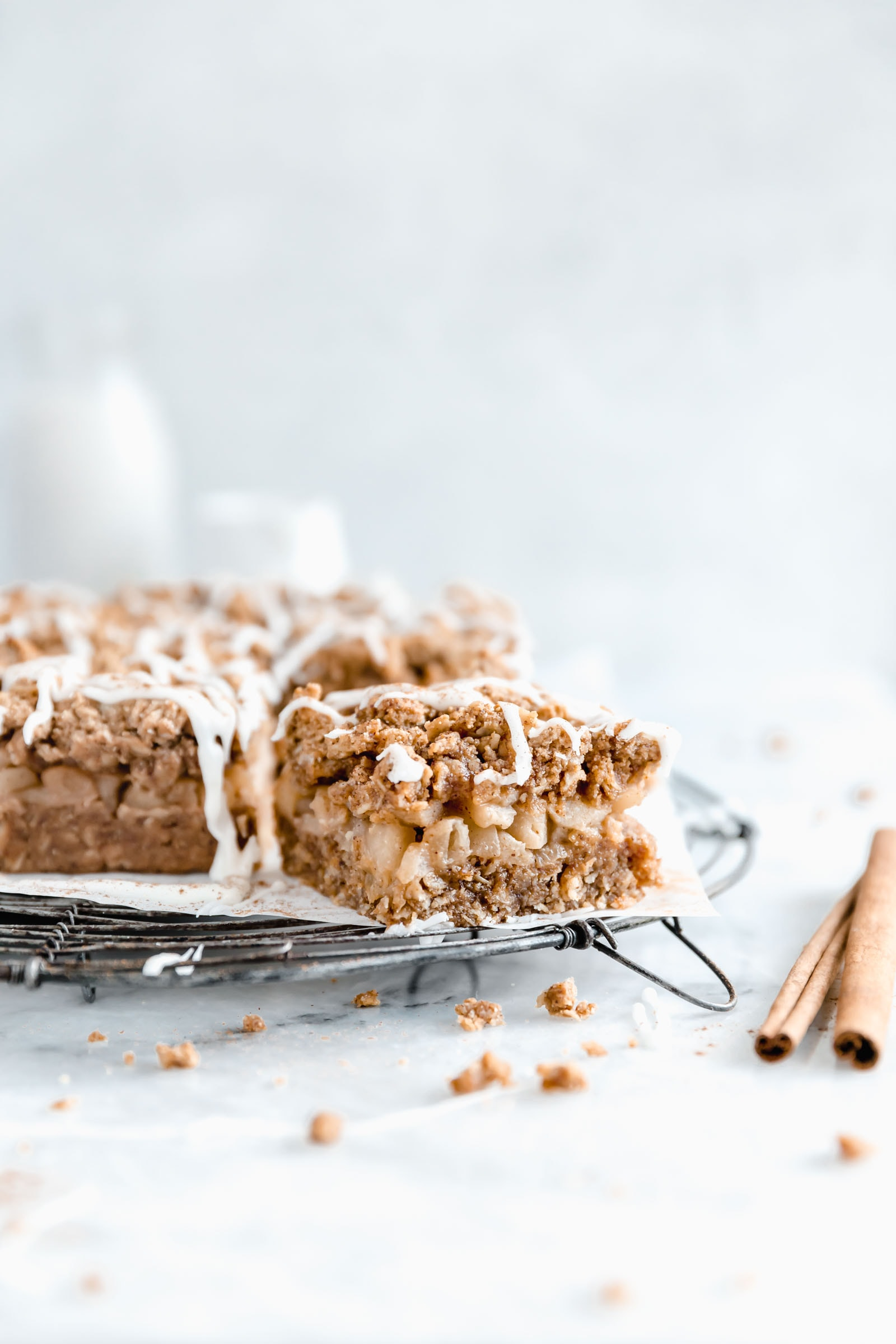 Healthy apple pie bars with one slice out from the pan
