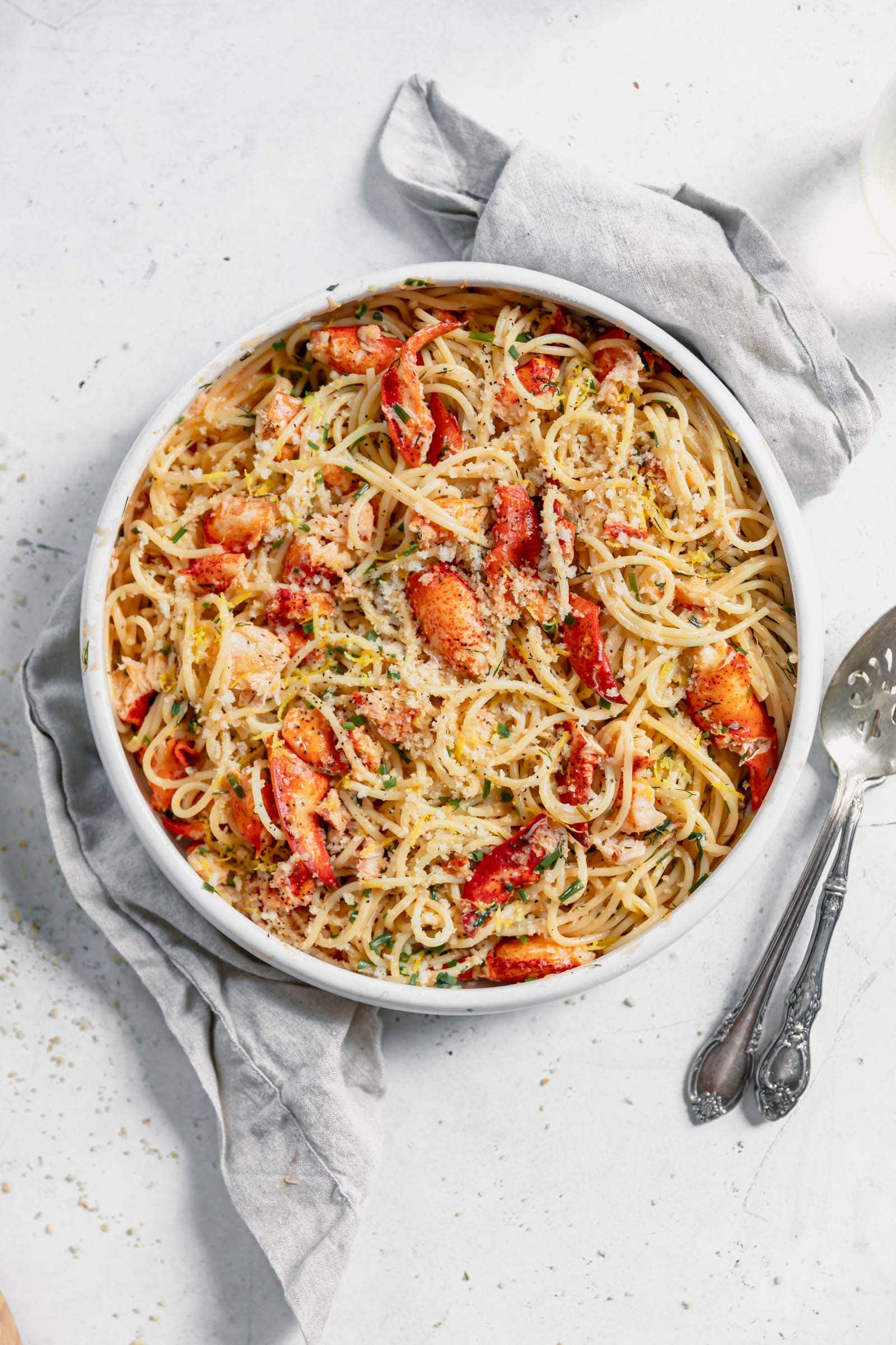lobster pasta in a large bowl loaded with fresh lobster in a luscious butter sauce