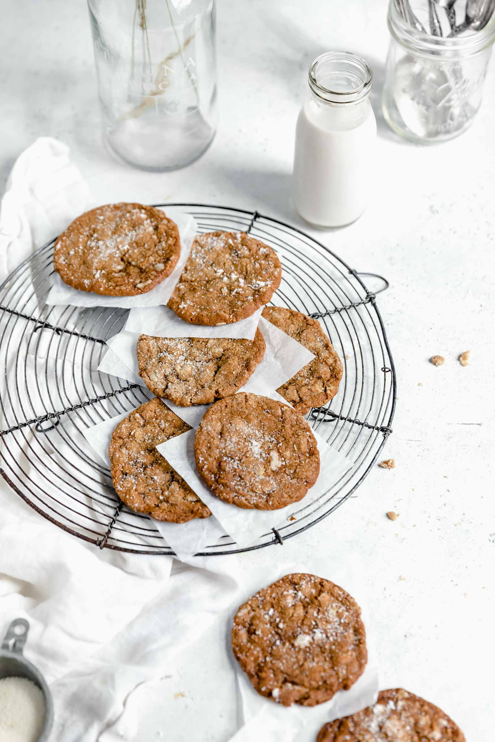ginger oatmeal cookies coated in sugar on a cooling rack