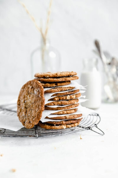 stack of oamteal molasses cookies with a glass of milk