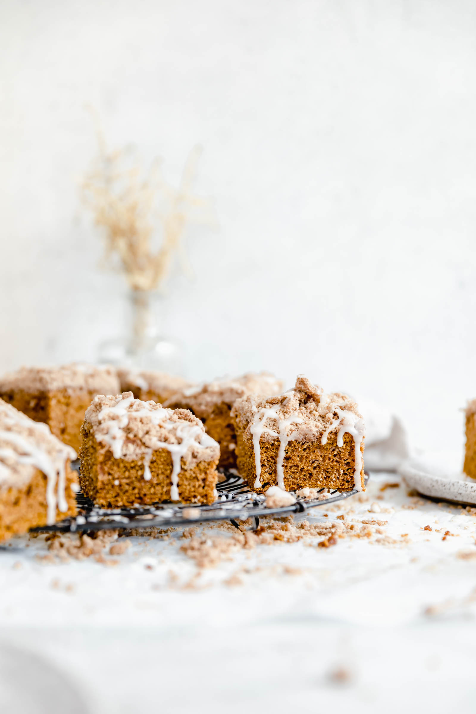 head on shot of pumpkin coffee cake with cinnamon cream cheese glaze