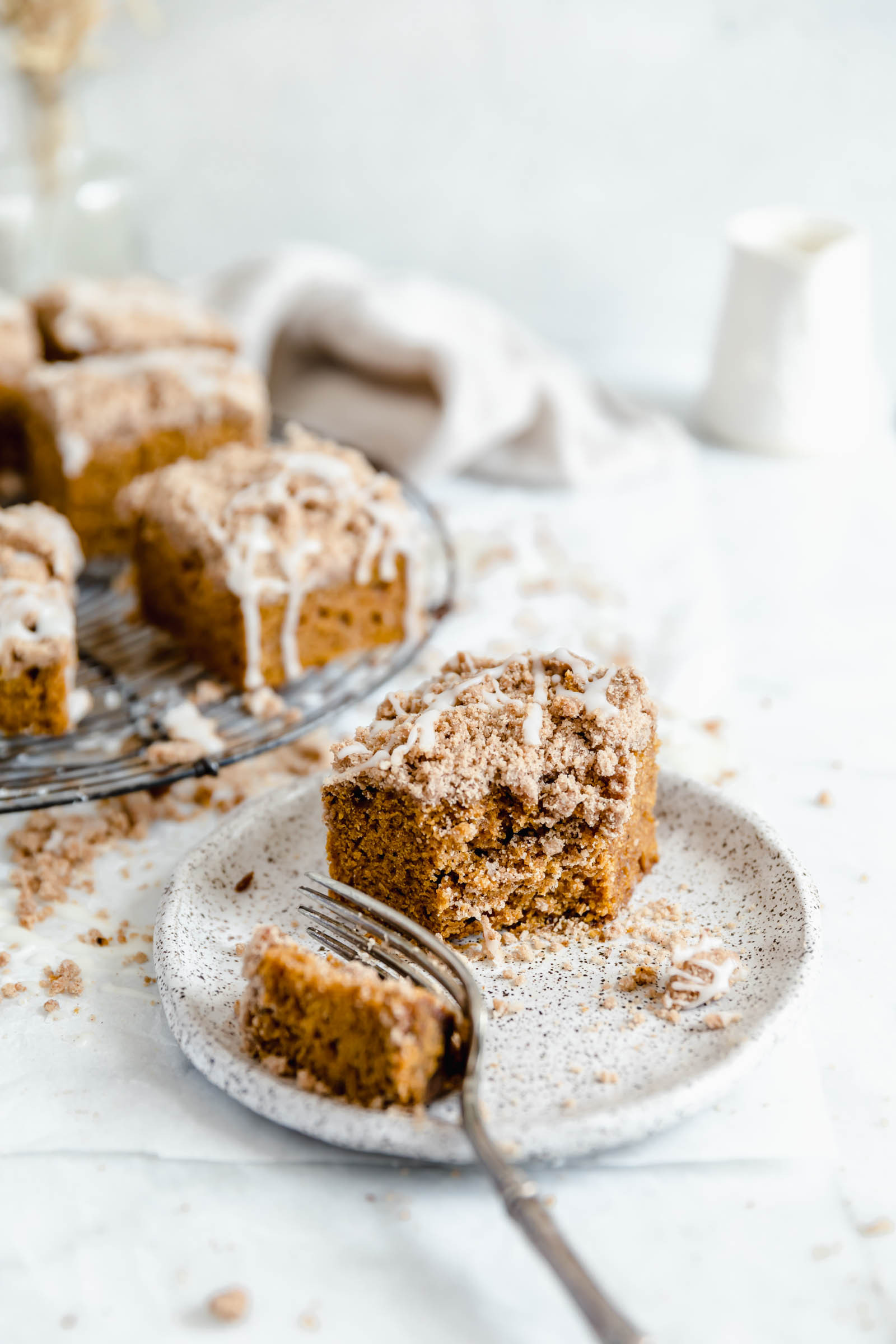 slice of pumpkin crumb coffee cake with a bite taken out