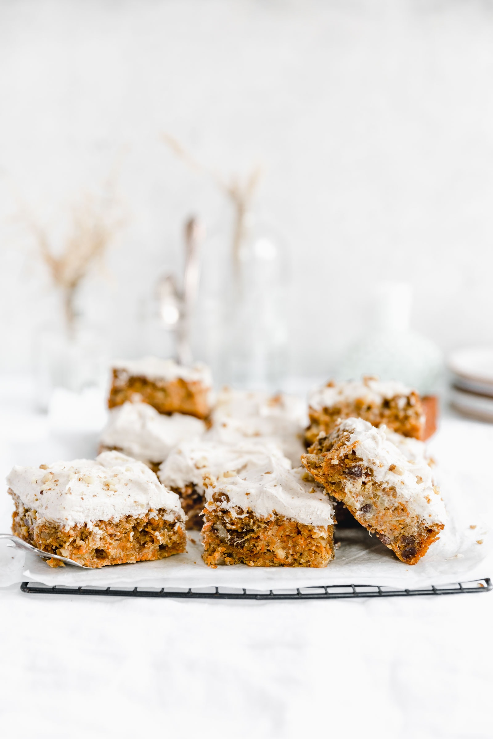 carrot sheet cake pieces on a cooling rack