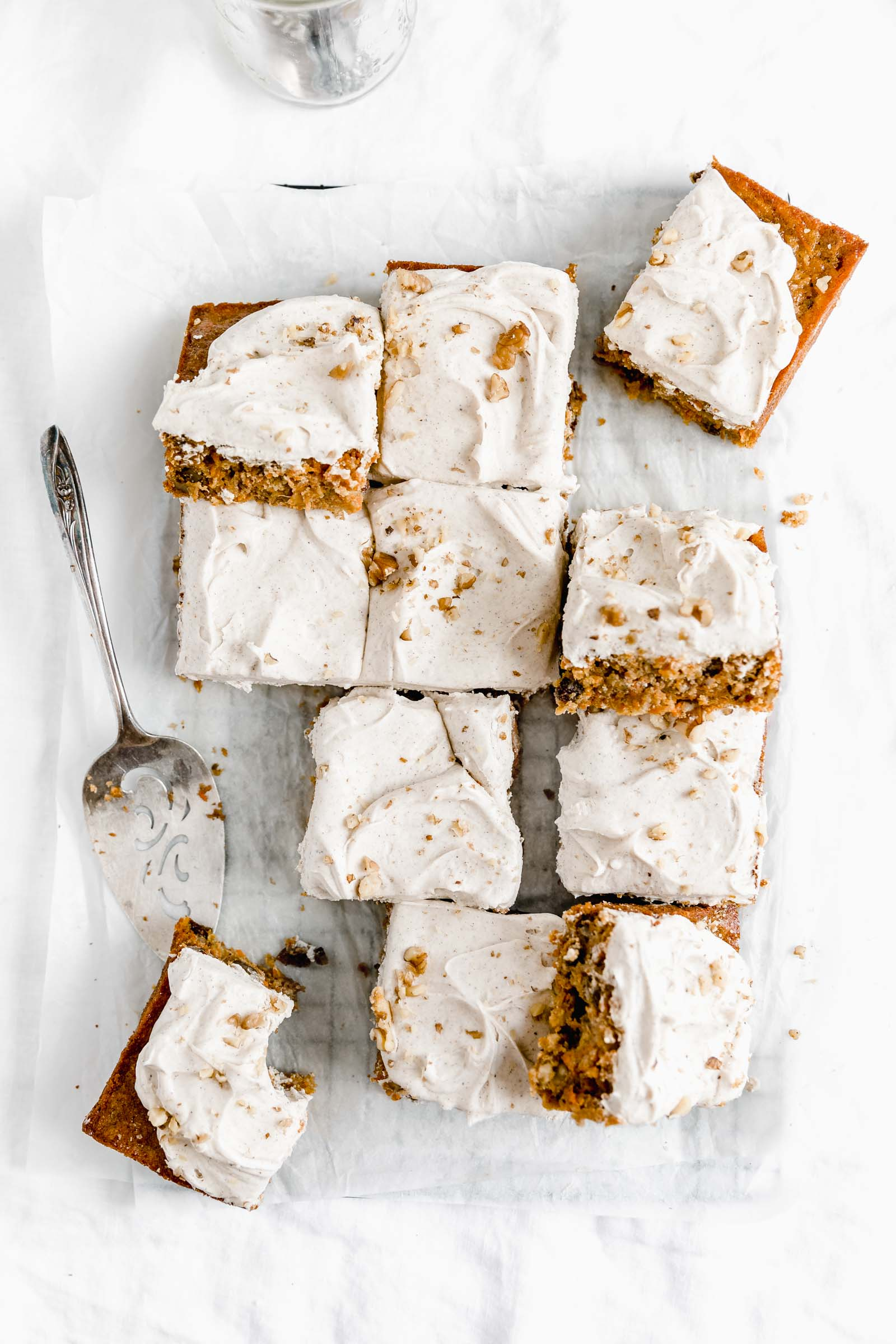 overhead shot of carrot cake sheet cake with a spoonful of frosting