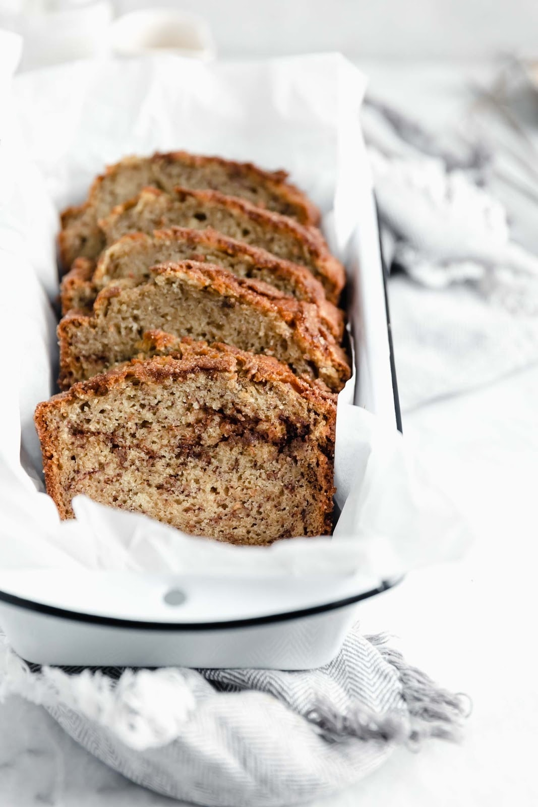 snickerdoodle banana bread sliced and fanned out in loaf pan