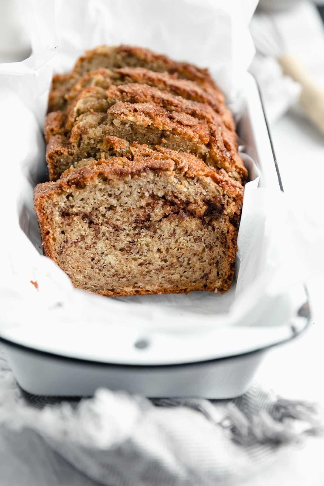 cinnamon sugar banana bread with cinnamon swirl in loaf pan
