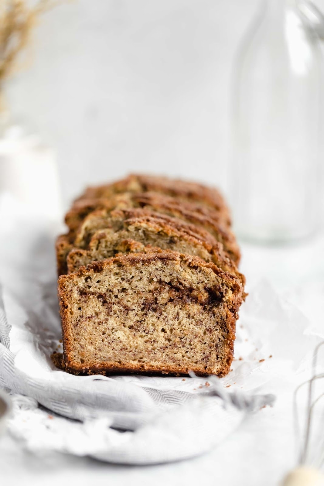 slices of snickerdoodle banana bread with a thick cinnamon sugar swirl