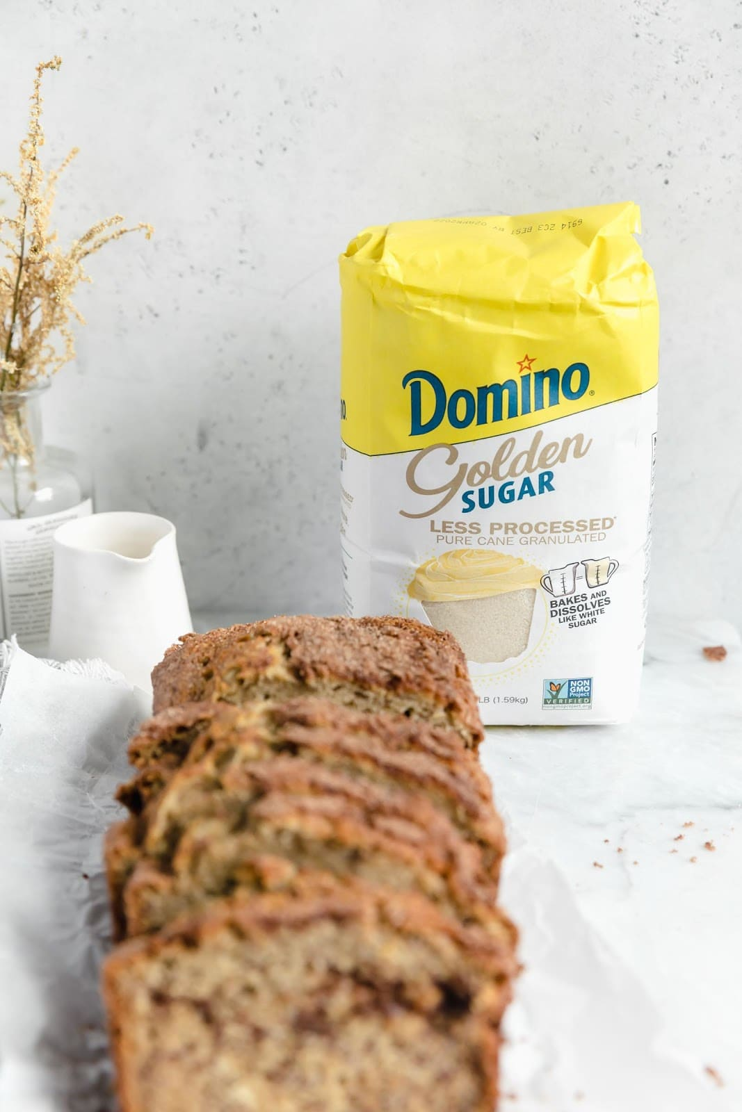 slices of snickerdoodle banana bread with domino golden sugar