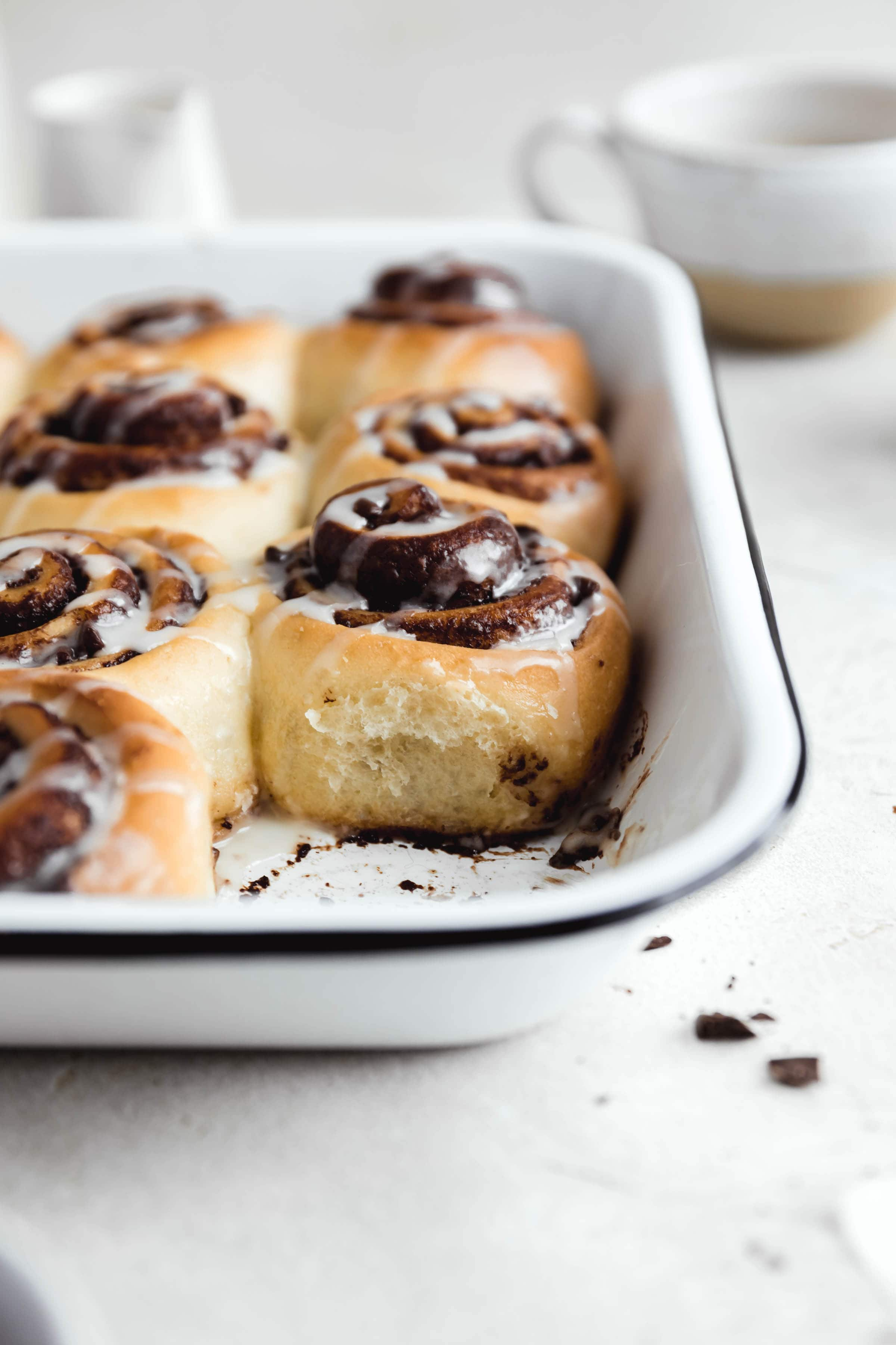 scrumptious pan of chocolate cinnamon rolls with one taken out