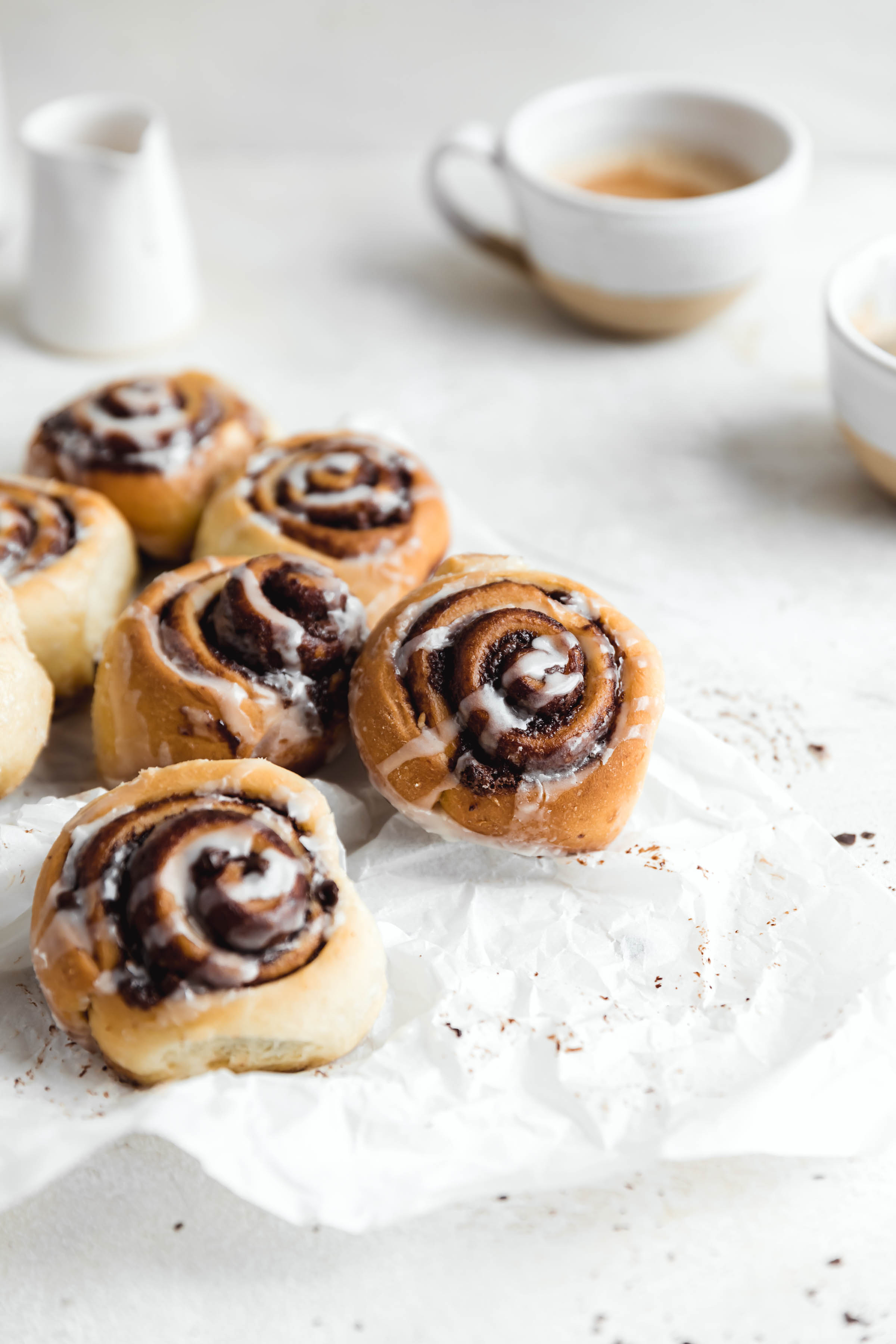 chocolate cinnamon rolls on parchment paper perfect for a weekend breakfast this holiday season