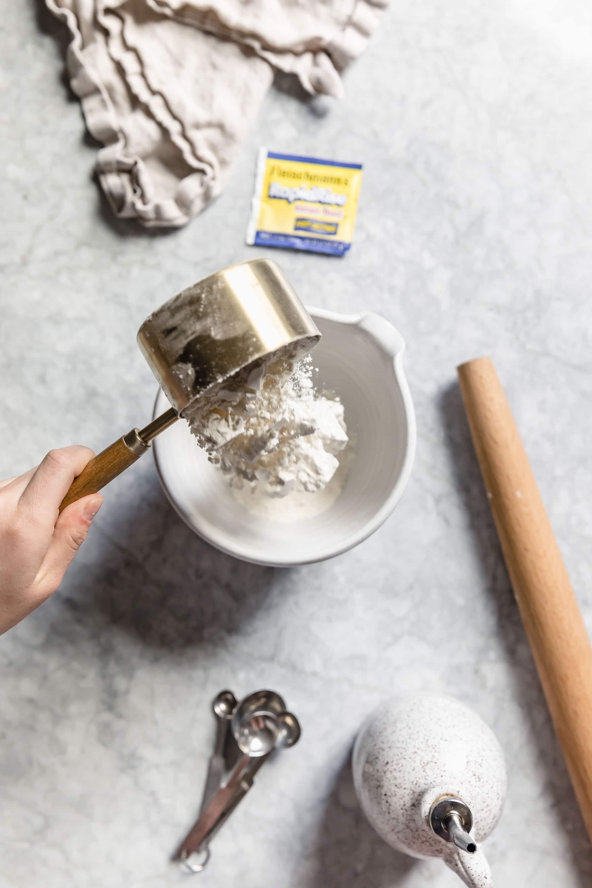 flour pouring into bowl