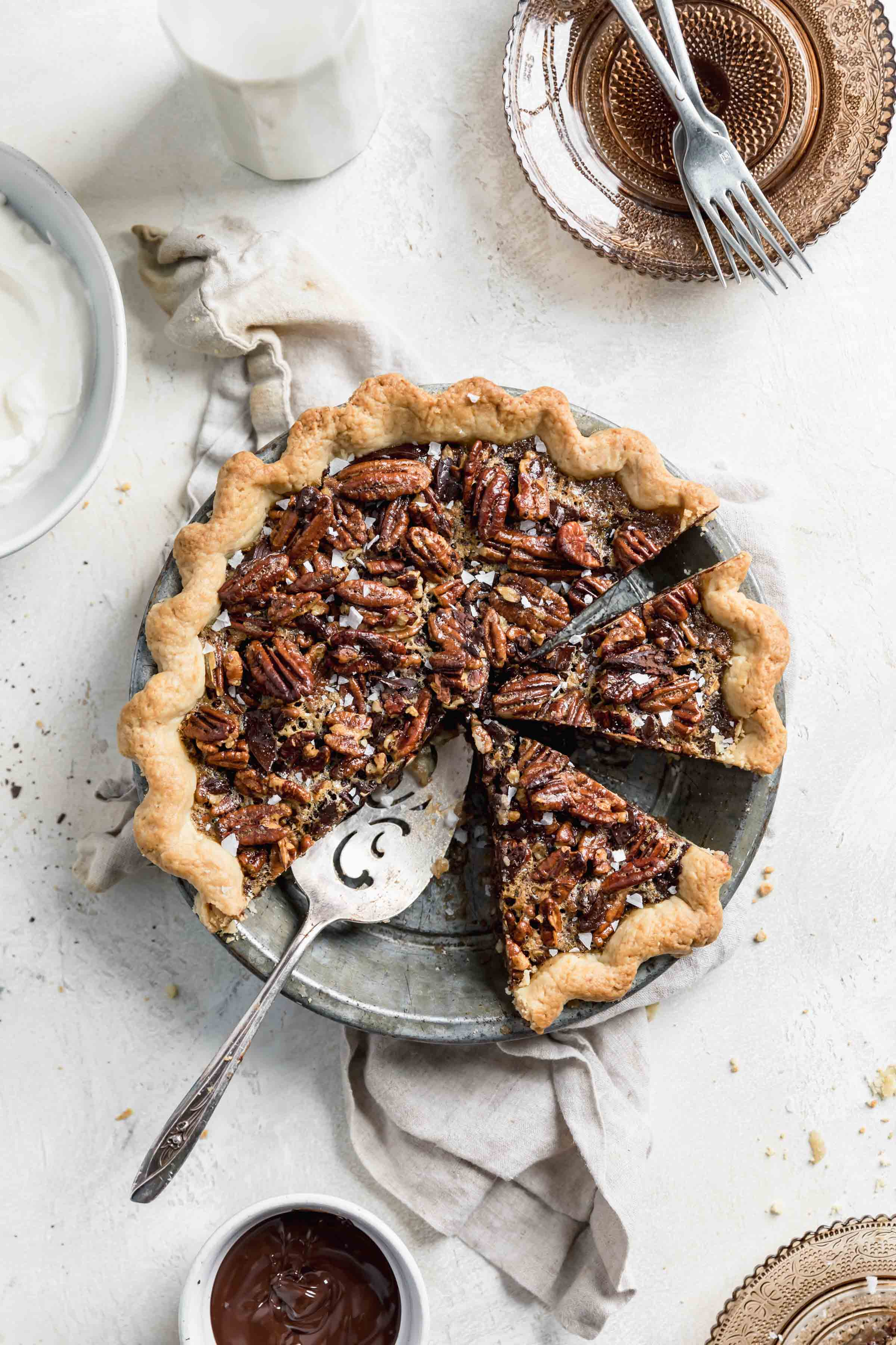 Take your pie game to the next level this Thanksgiving with this Bourbon Chocolate Pecan Pie. Loaded with chocolate chunks and a splash of bourbon, this pecan pie is the perfect ending to your Thanksgiving feast!