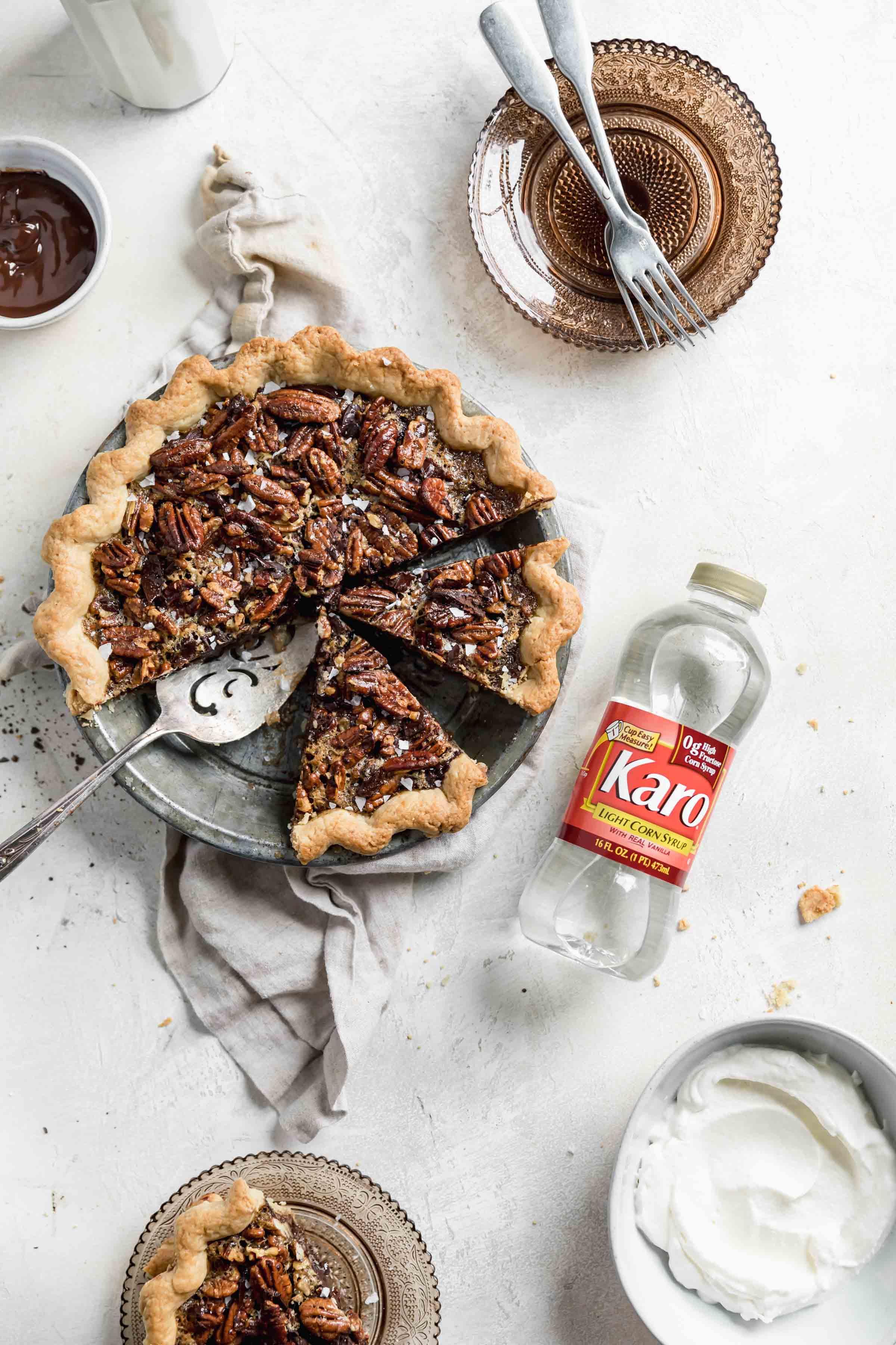 overhead shot of bourbon chocolate pecan pie with karo syrup