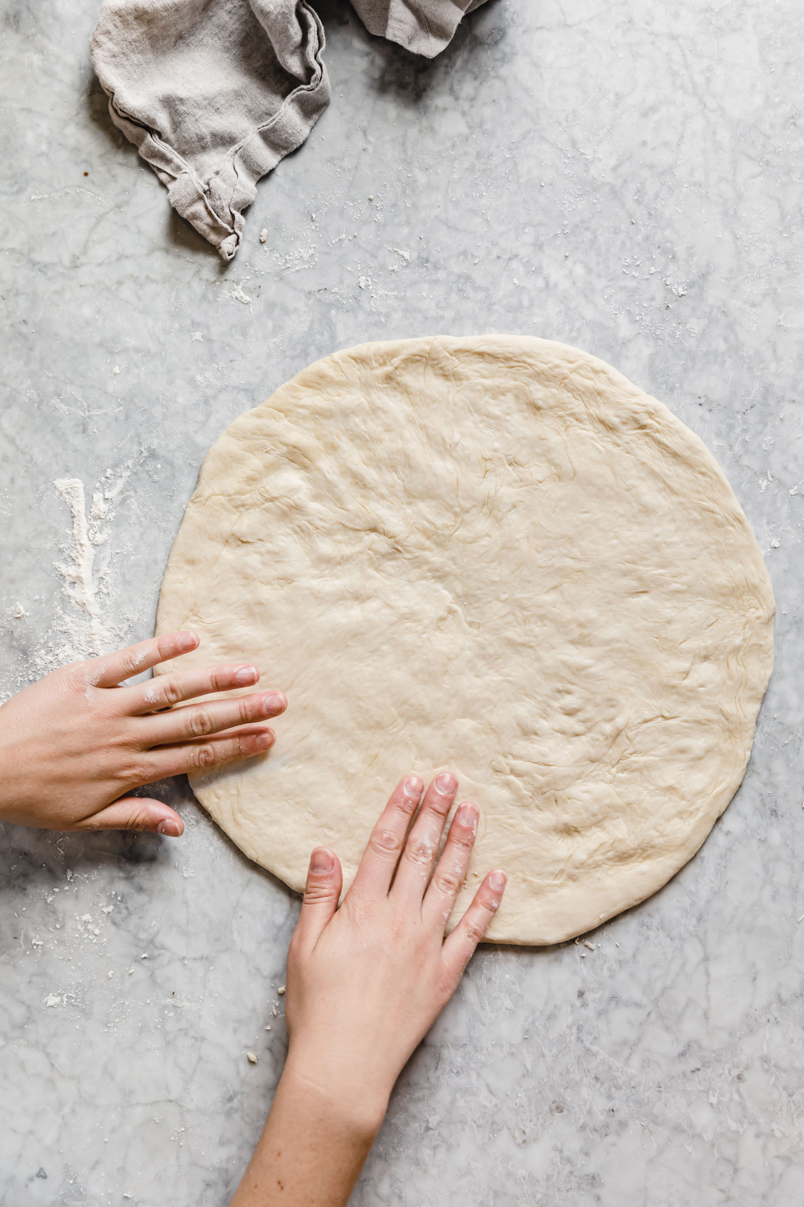 stretch out pizza dough to a 12 inch round