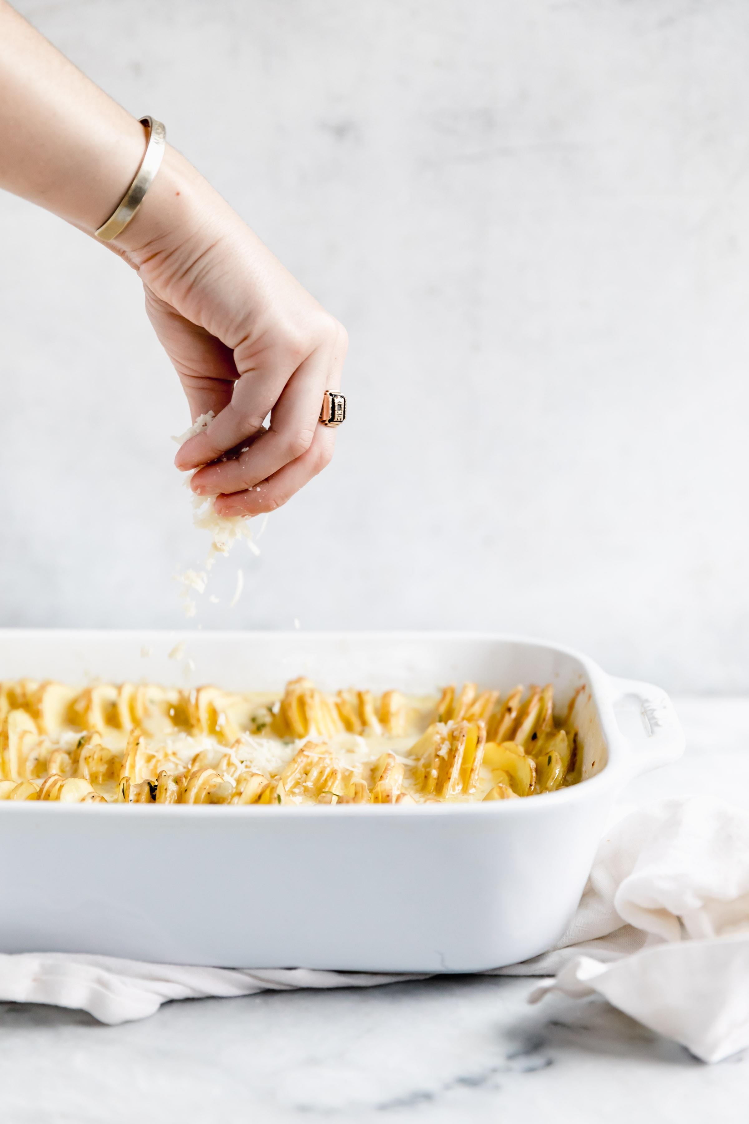 sprinkle cheese onto potatoes