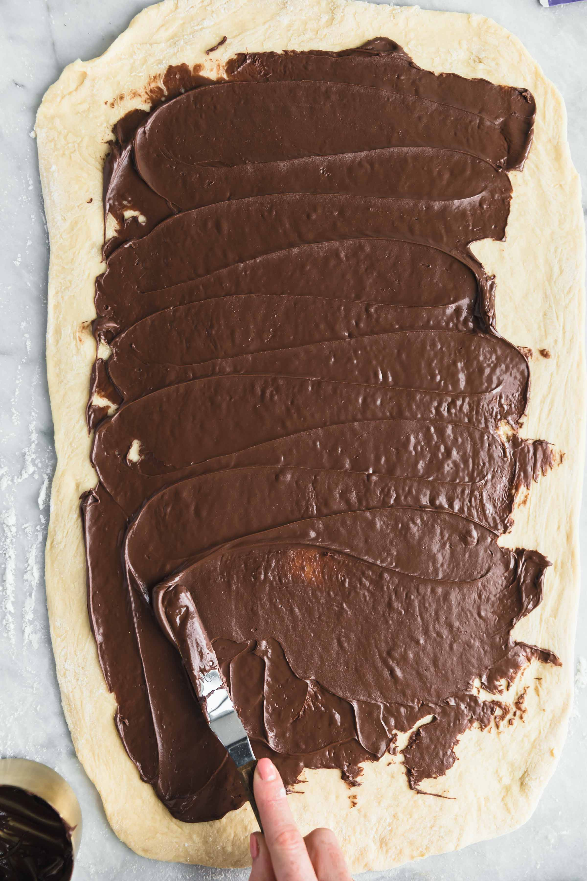 spread the chocolate spread using an offset spatula