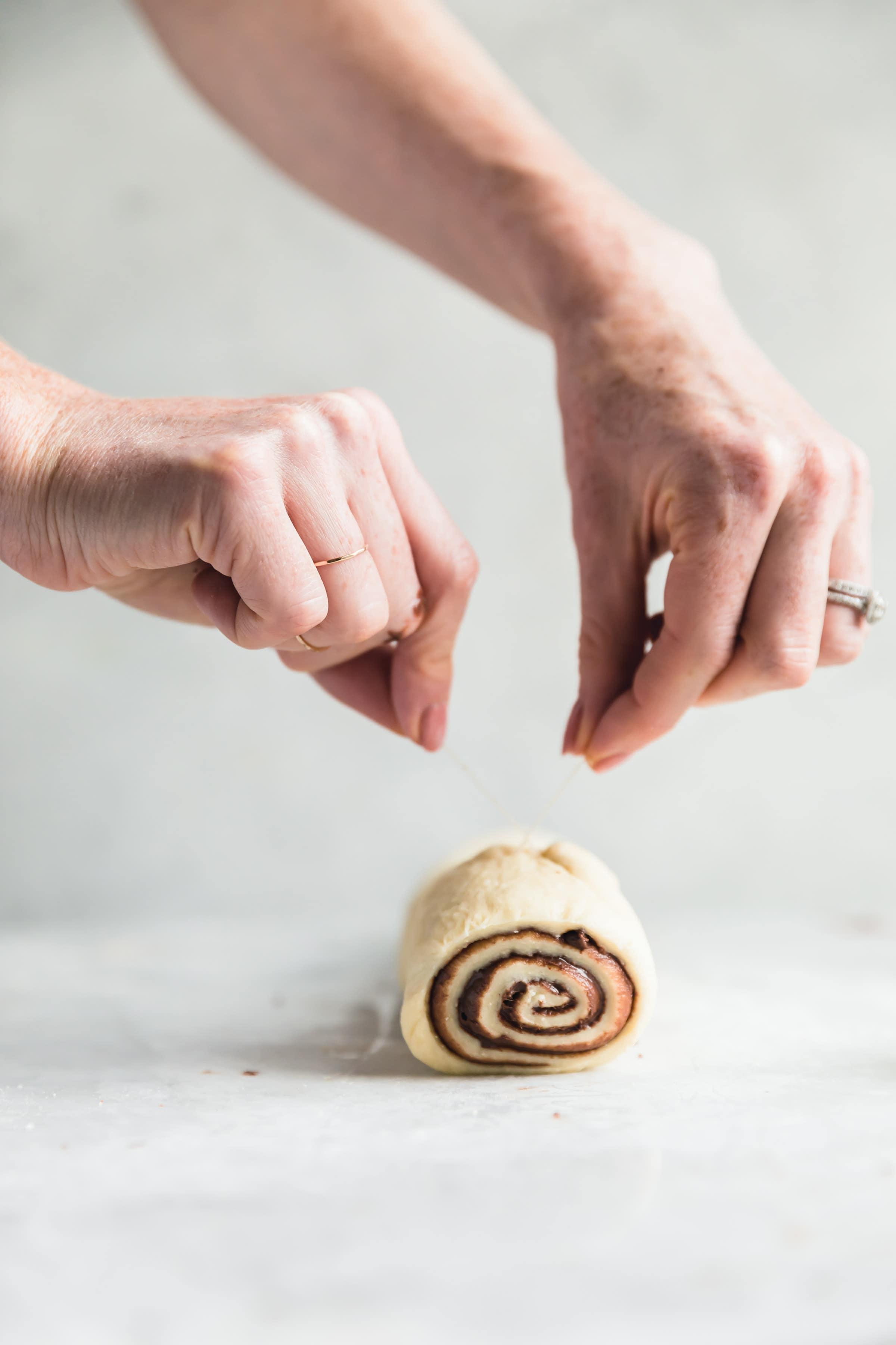 cinnamon roll dough cut with floss