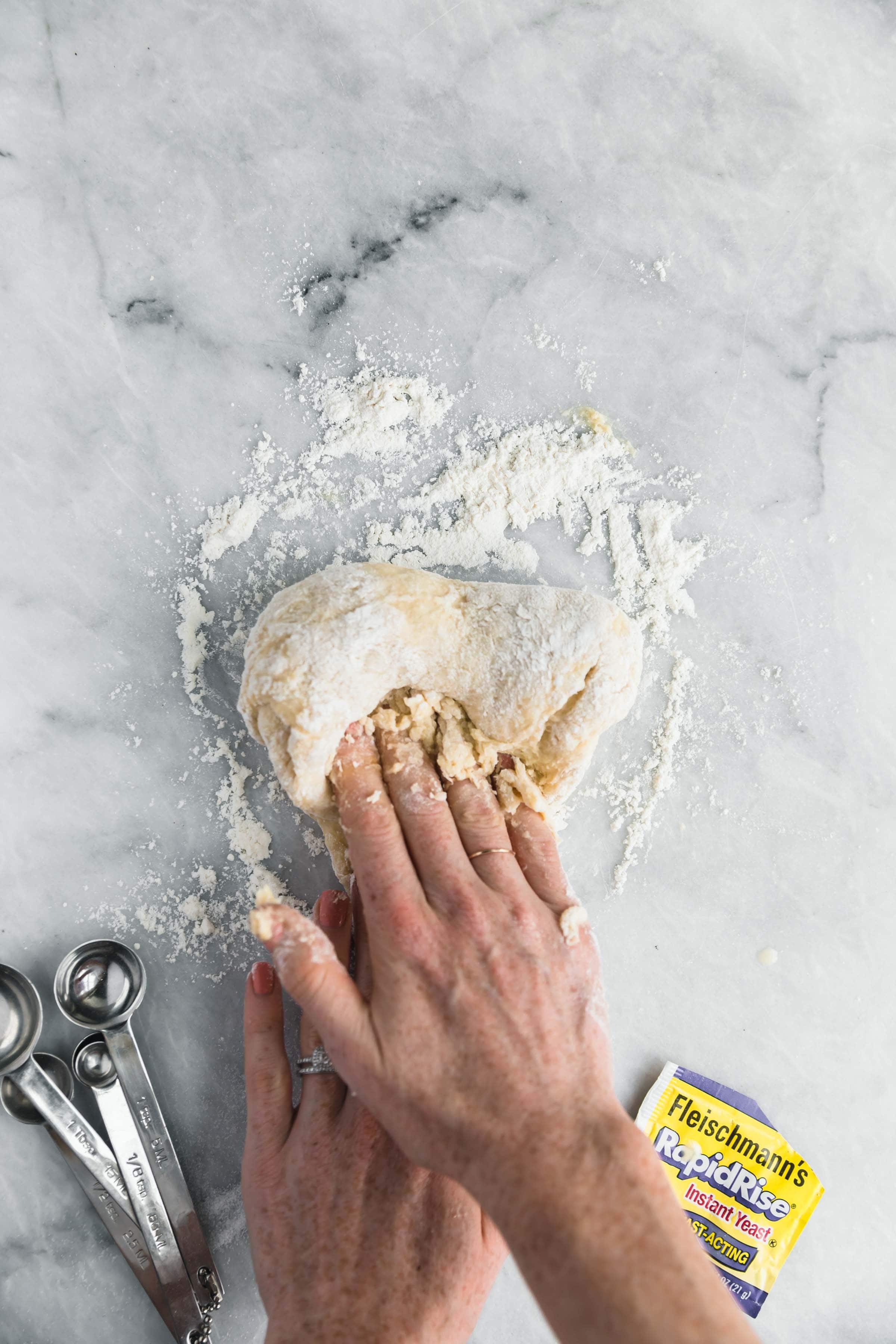 knead the cinnamon roll dough by hand