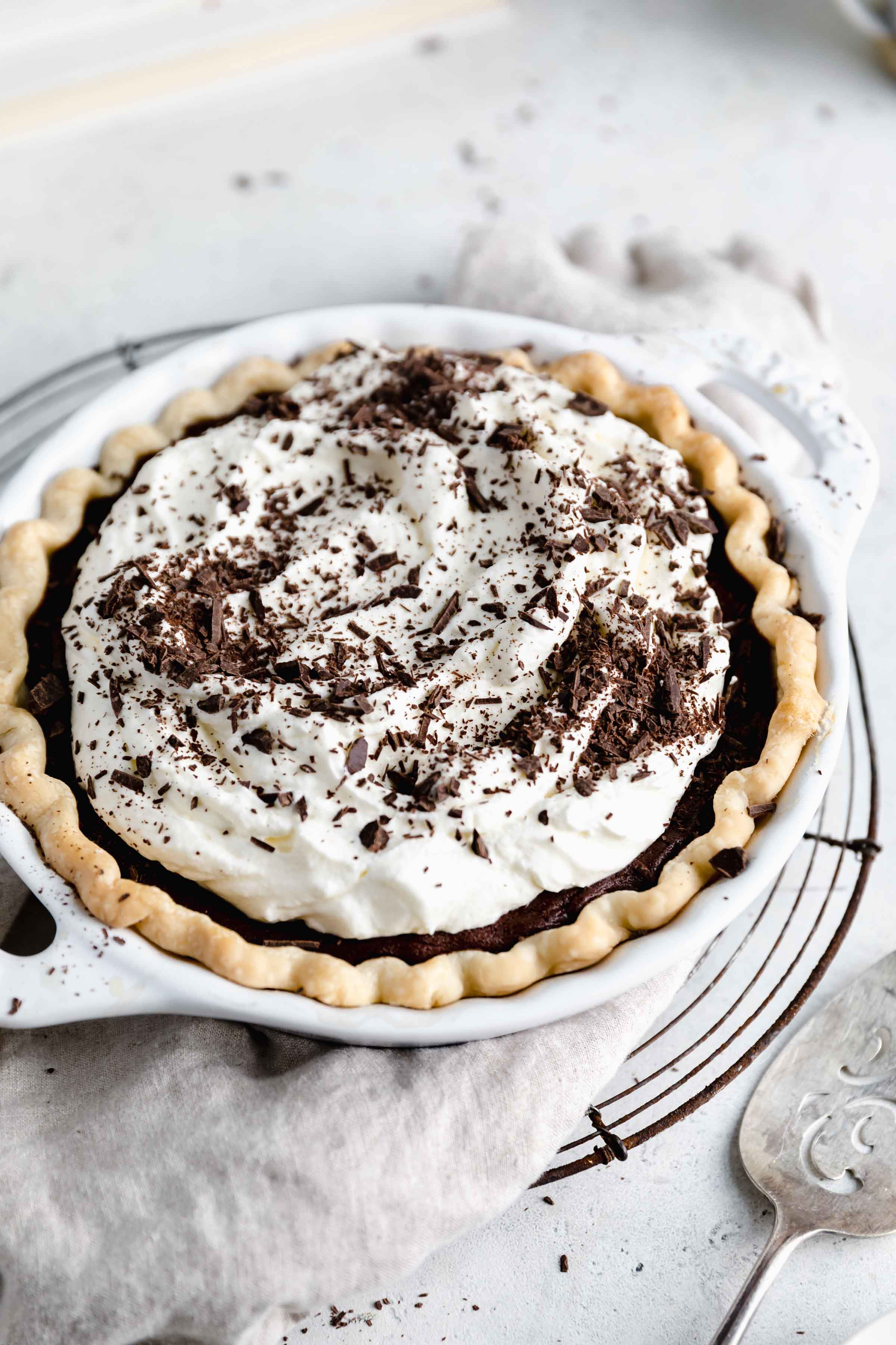 overhead shot of chocolate cream pie topped with chocolate shavings