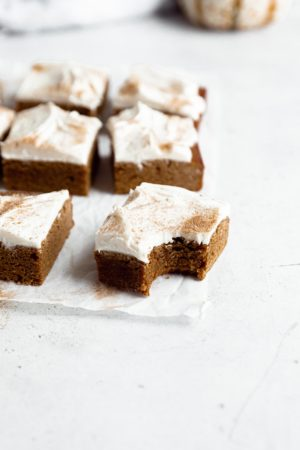 Gingerbread blondies in three rows with one piece slightly out