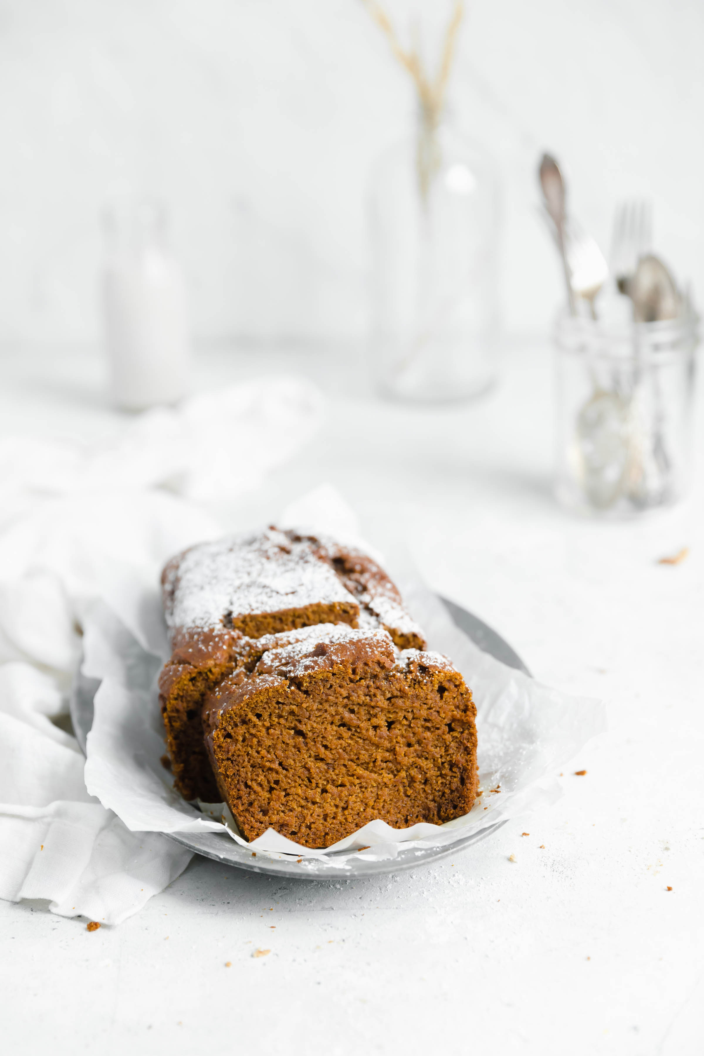 head on shot of gluten free pumpkin bread slices with powdered sugar sprinkled on top