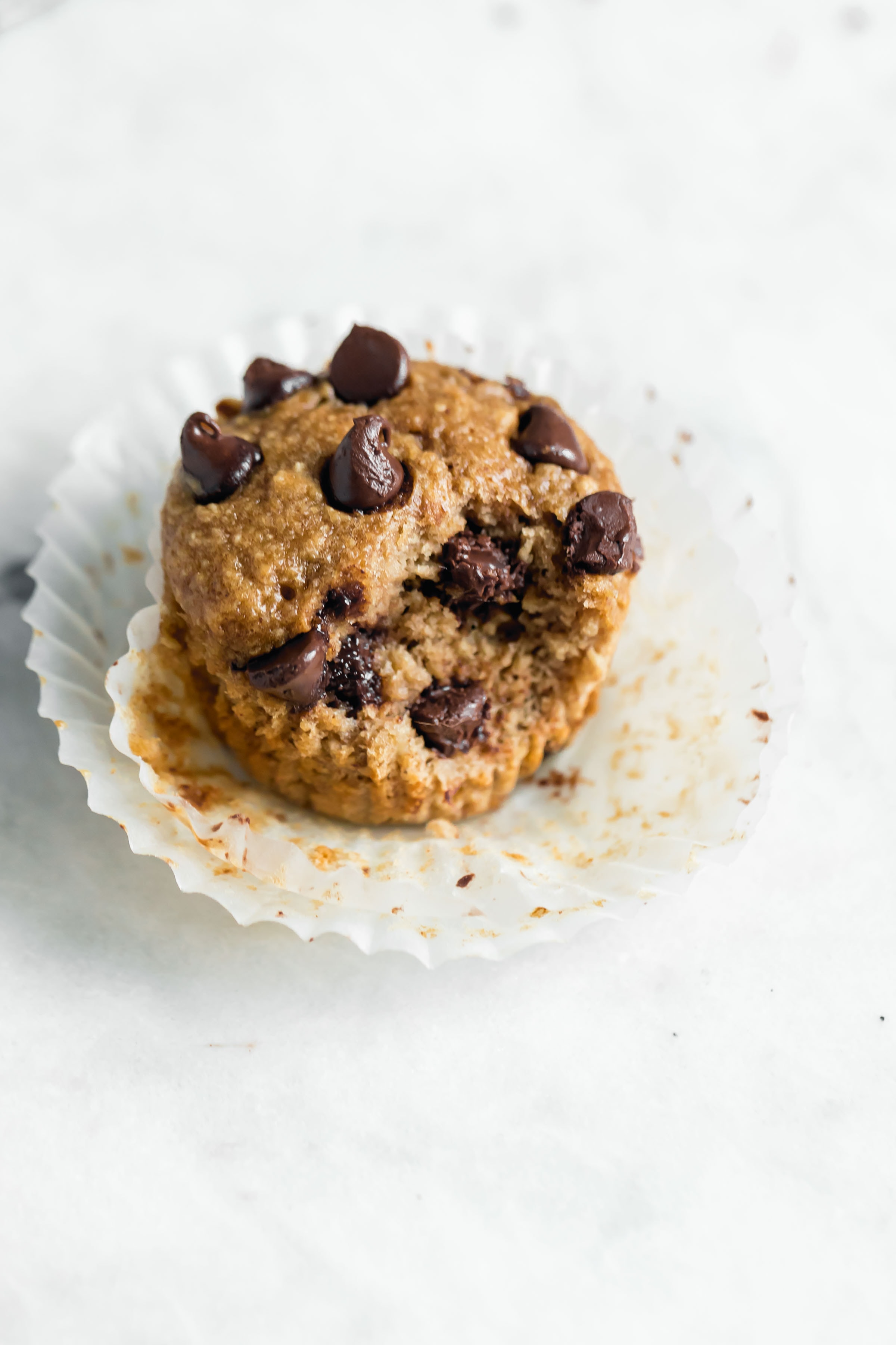 These gluten free healthy peanut butter banana muffins studded with chocolate chips are our new favorite breakfast food :)