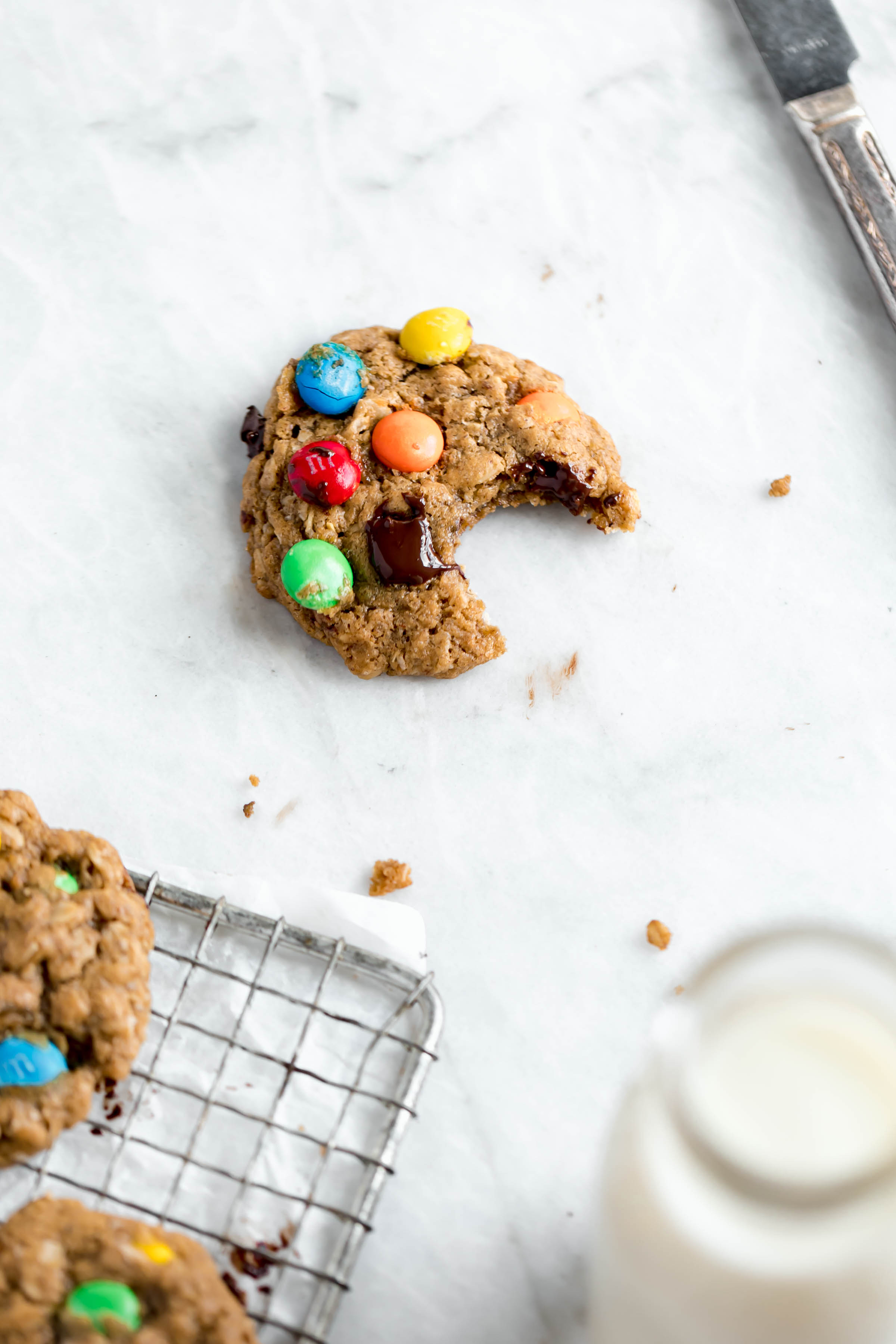 healthy monster cookie overhead shot with a glass of milk