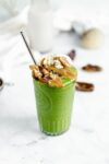 matcha collagen green smoothie with almond butter, matcha powder, banana, mango, and chia. the perfect way to start your morning!
