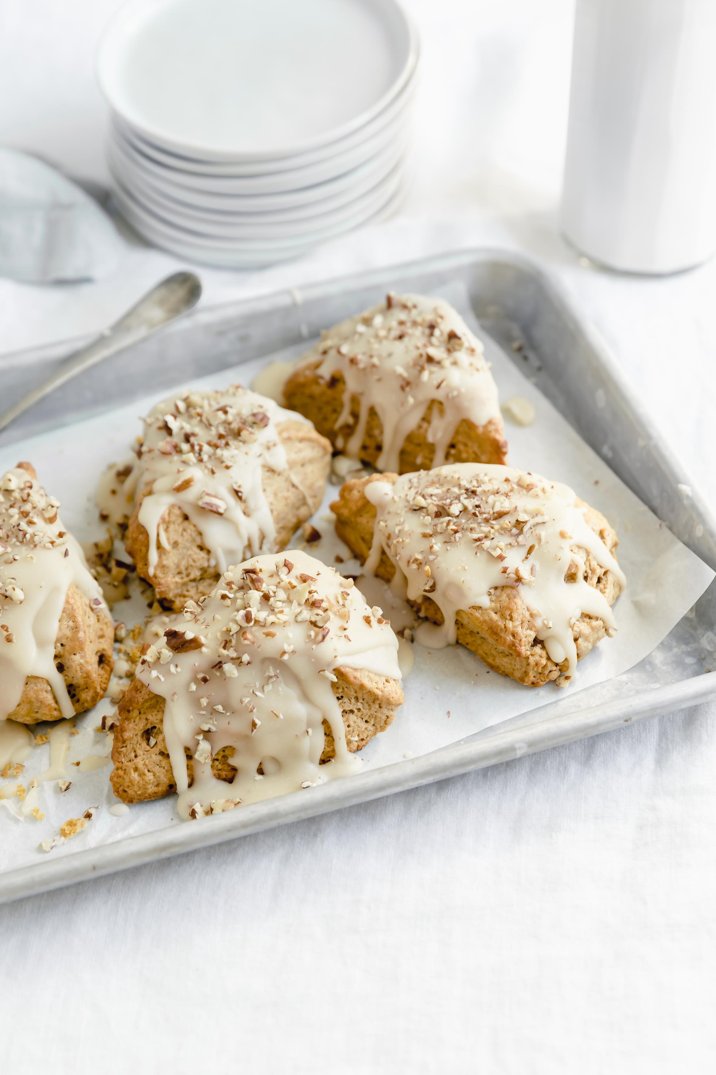 pan of moist pumpkin scones with maple glaze