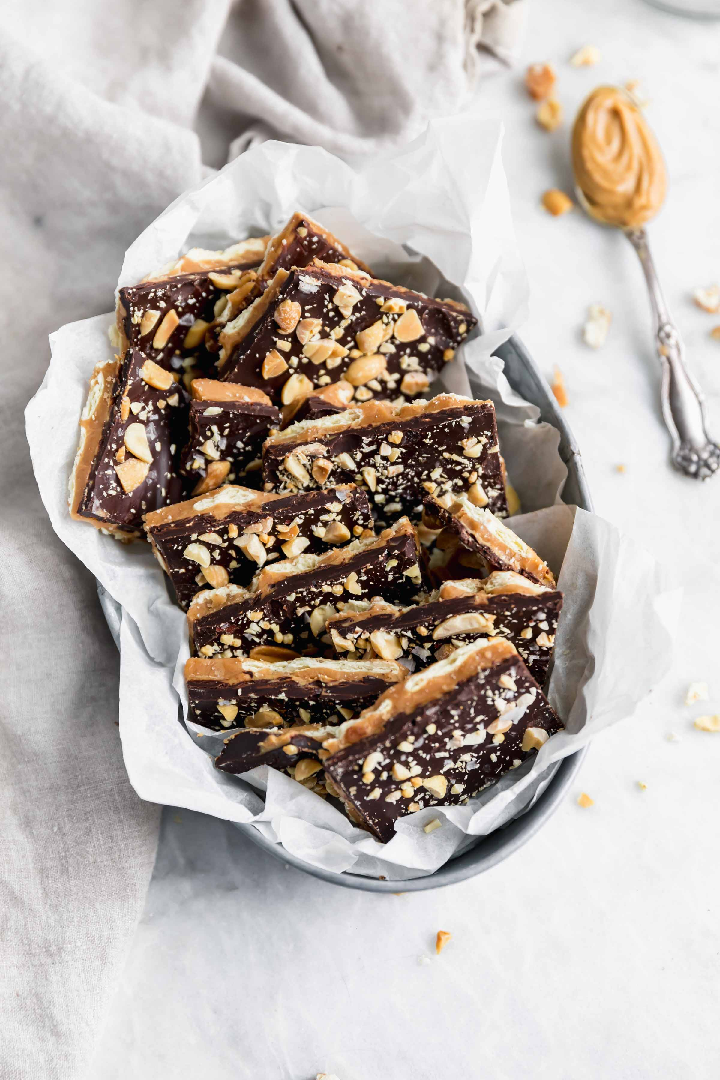 A crowd-pleasing sweet, salty, crunchy, and smooth Peanut Butter Toffee bark made entirely with ingredients you probably already have in your pantry! Hello, sweet thing!