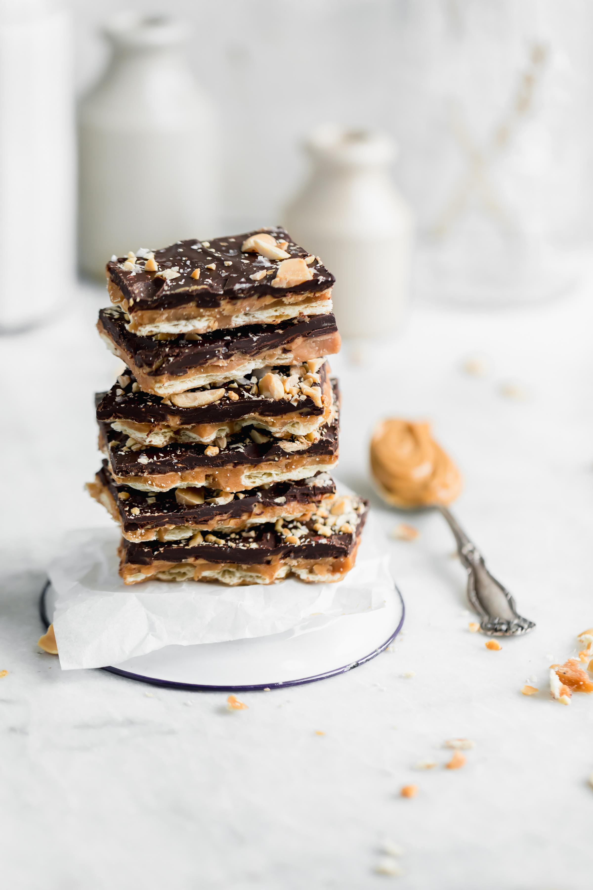 Stack of peanut butter saltine toffee bark. A crowd-pleasing sweet, salty, crunchy, and smooth Peanut Butter Toffee bark made entirely with ingredients you probably already have in your pantry! Hello, sweet thing!