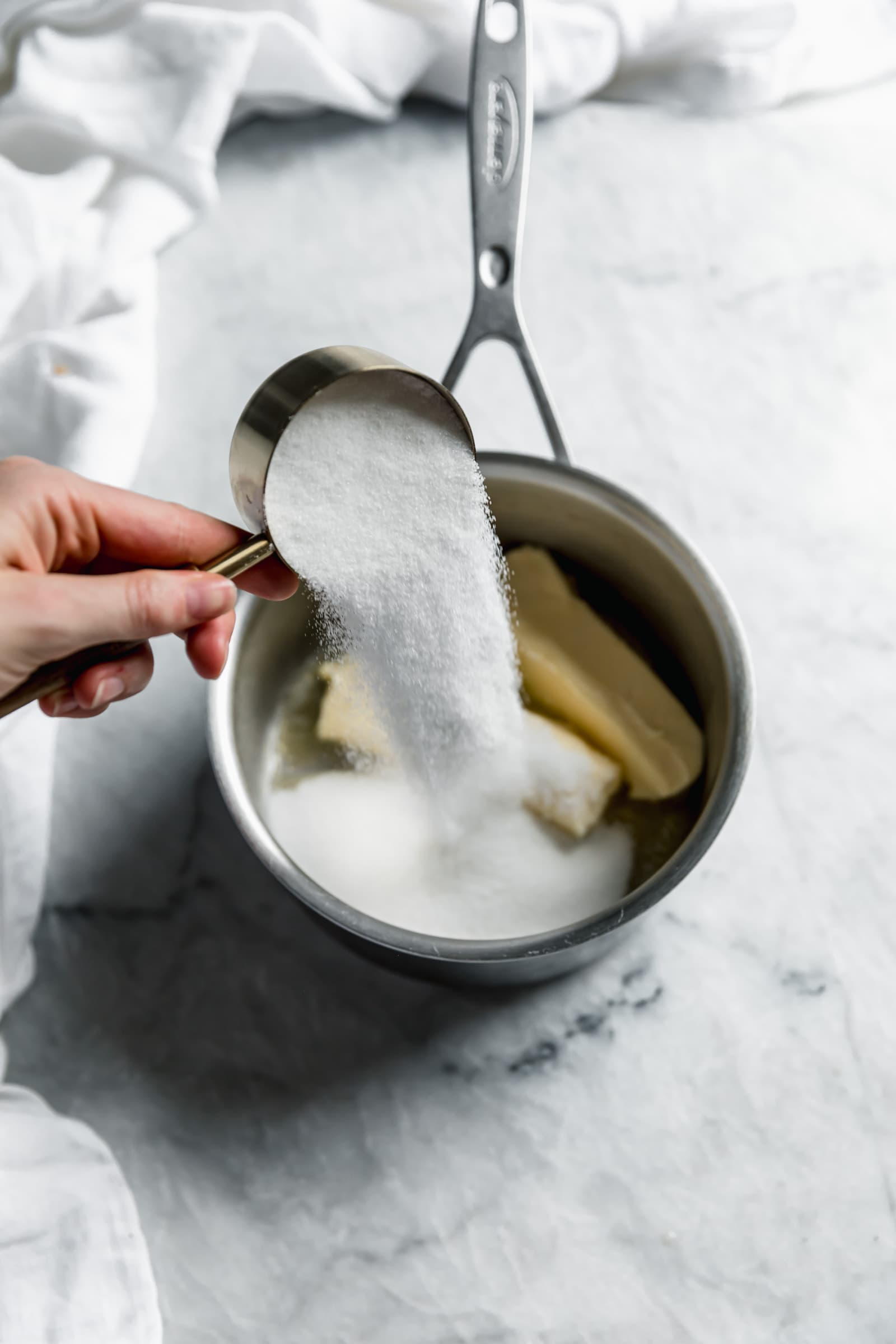 sugar pouring into pot