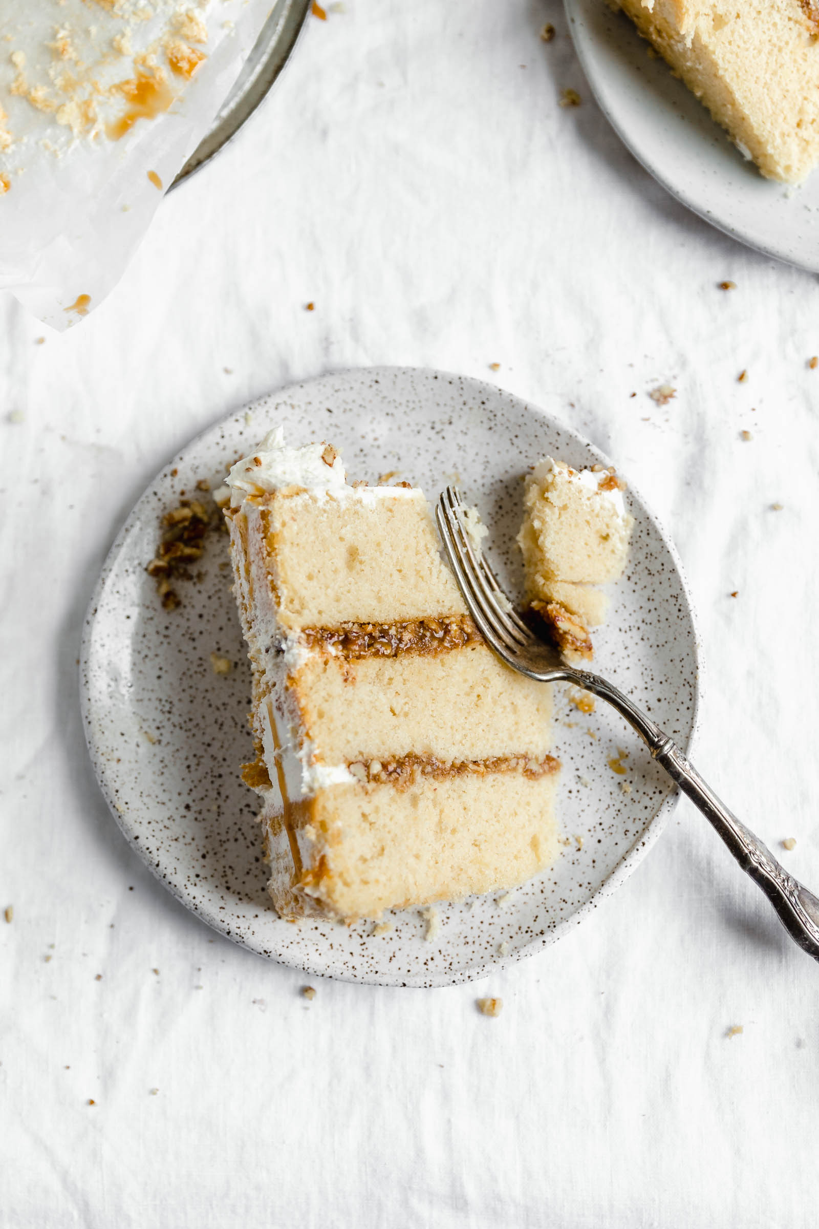 slice of praline layer cake with a bite taken out