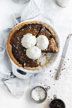 This is the salted caramel brownie pie of your dreams. Topped with vanilla ice cream and smothered in salted caramel sauce, you'd never believe how easy it is to make.