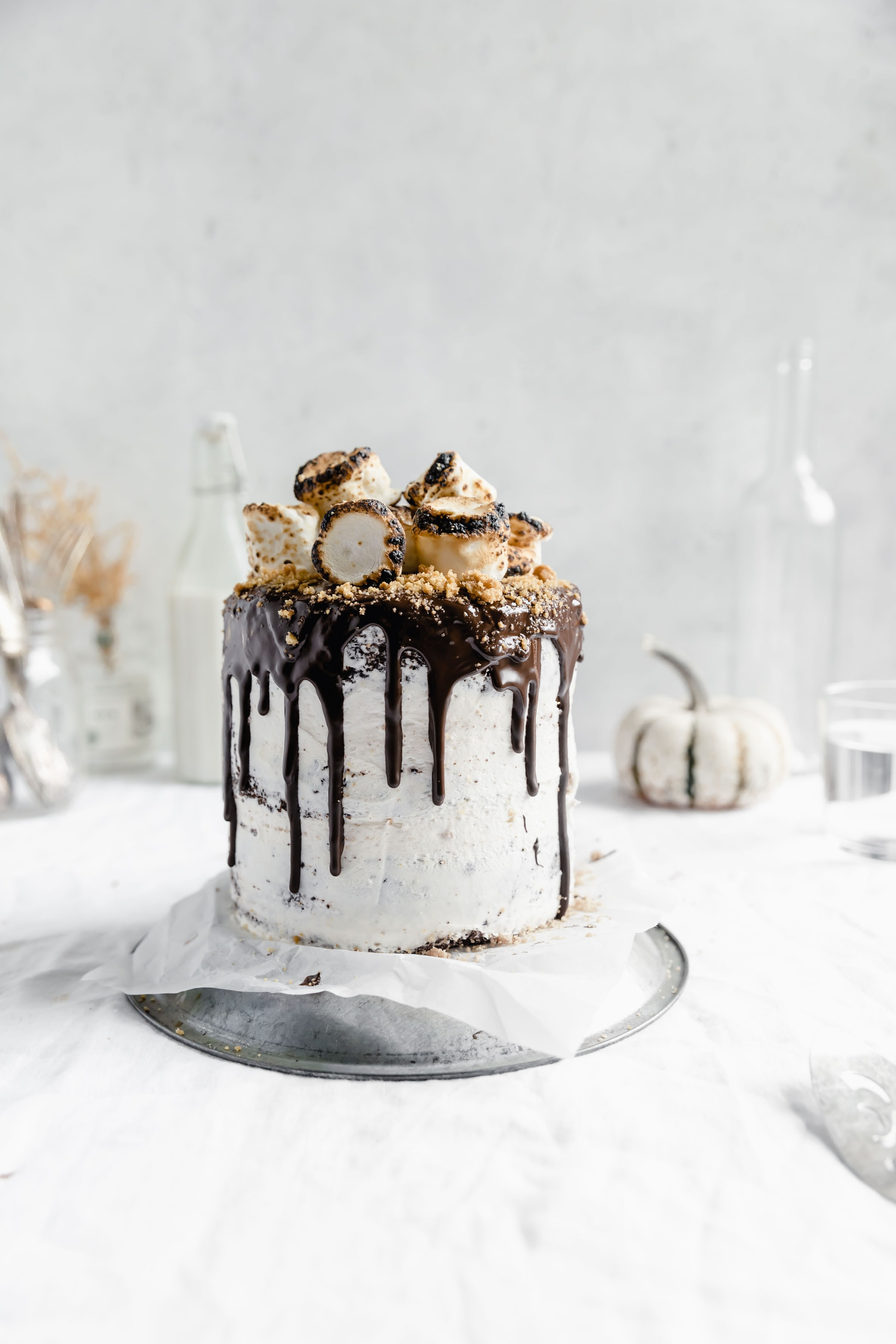 s'more layer cake AKA fudgy chocolate cake with a marshmallow and graham filling, marshmallow frosting, chocolate ganache, and topped with toasted marshmallows.YUM.