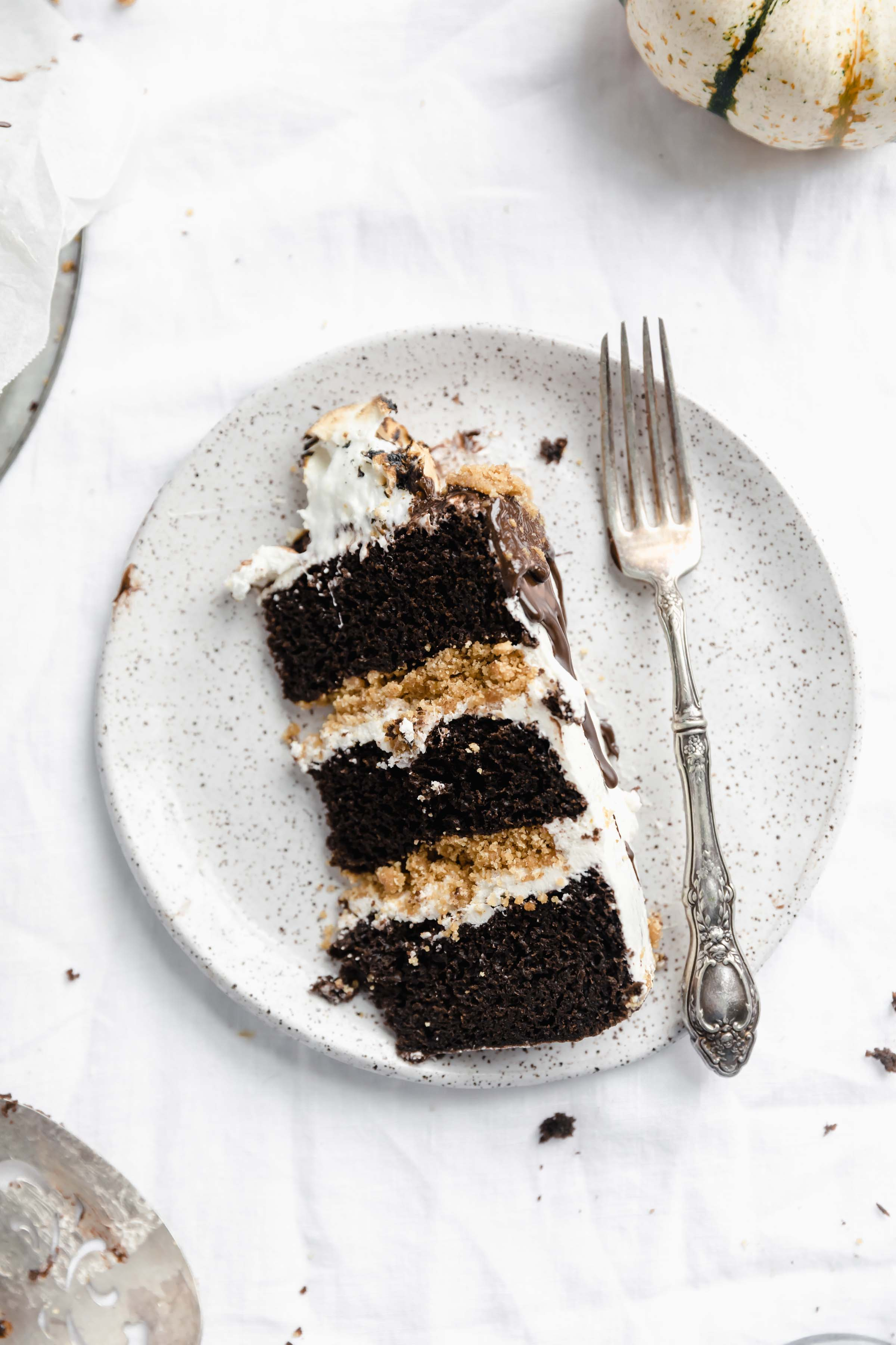 slice of s'mores cake with fork on a plate